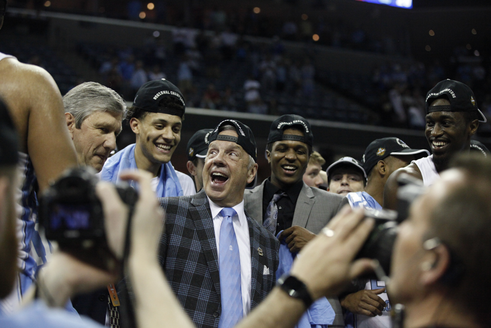 North Carolina celebrates wearing backwards hats after winning the South Region of the 2017 NCAA Tournament.