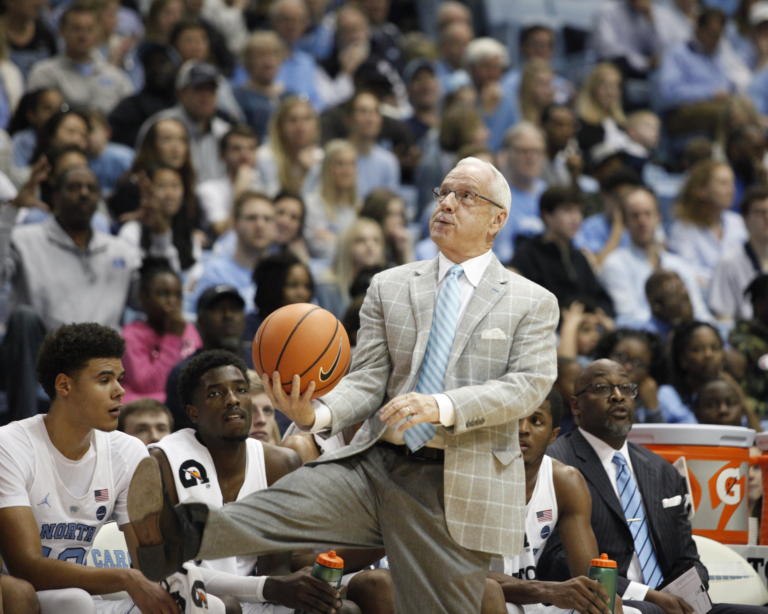 UNC head coach Roy Williams pretends to punt the basketball during the game against Pittsburgh at the Dean Smith Center.