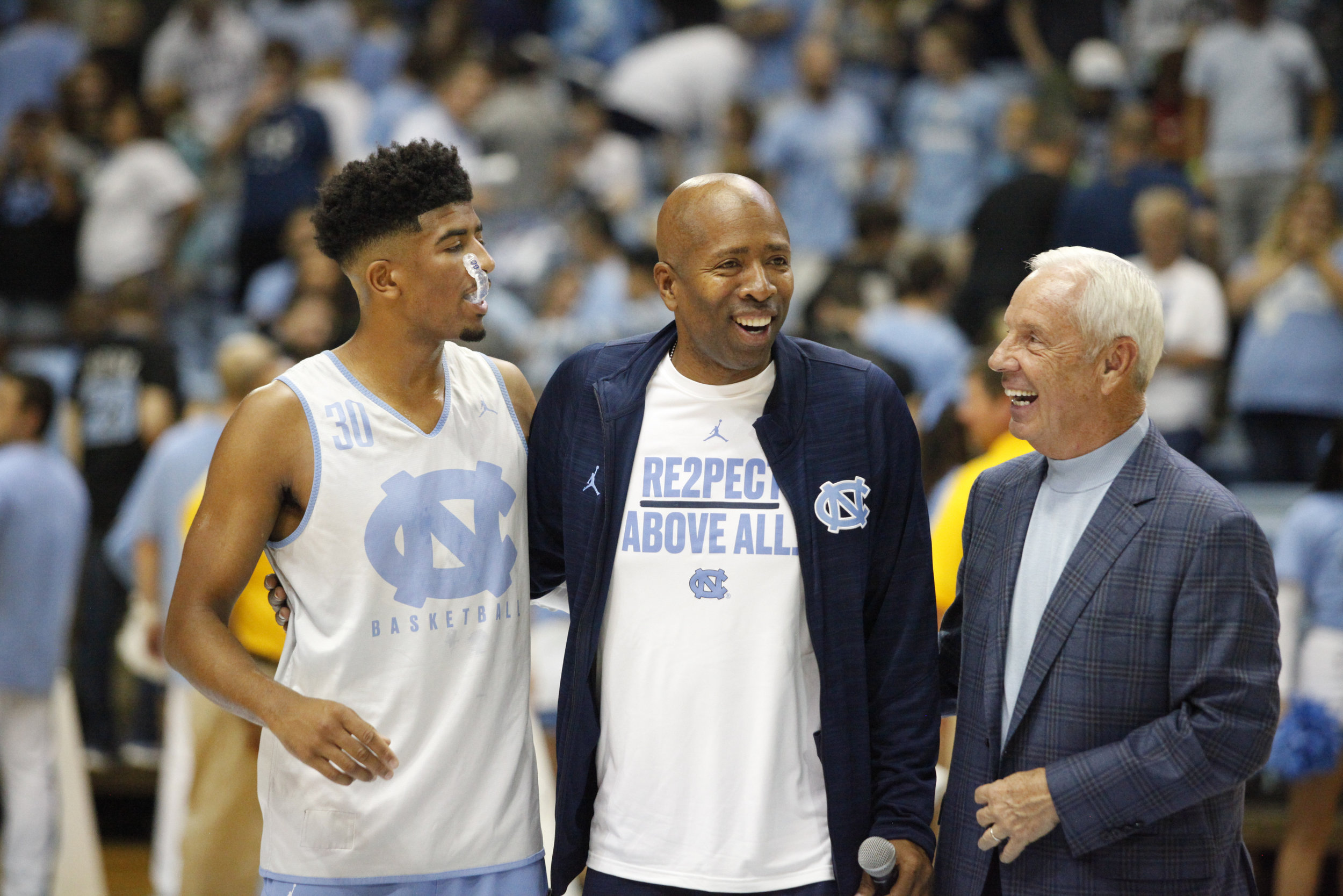 """UNC head coach Roy Williams with Kenny """"The Jet"""" Smith and his son, current walk-on at UNC, KJ Smith, during Late Night with Roy."""