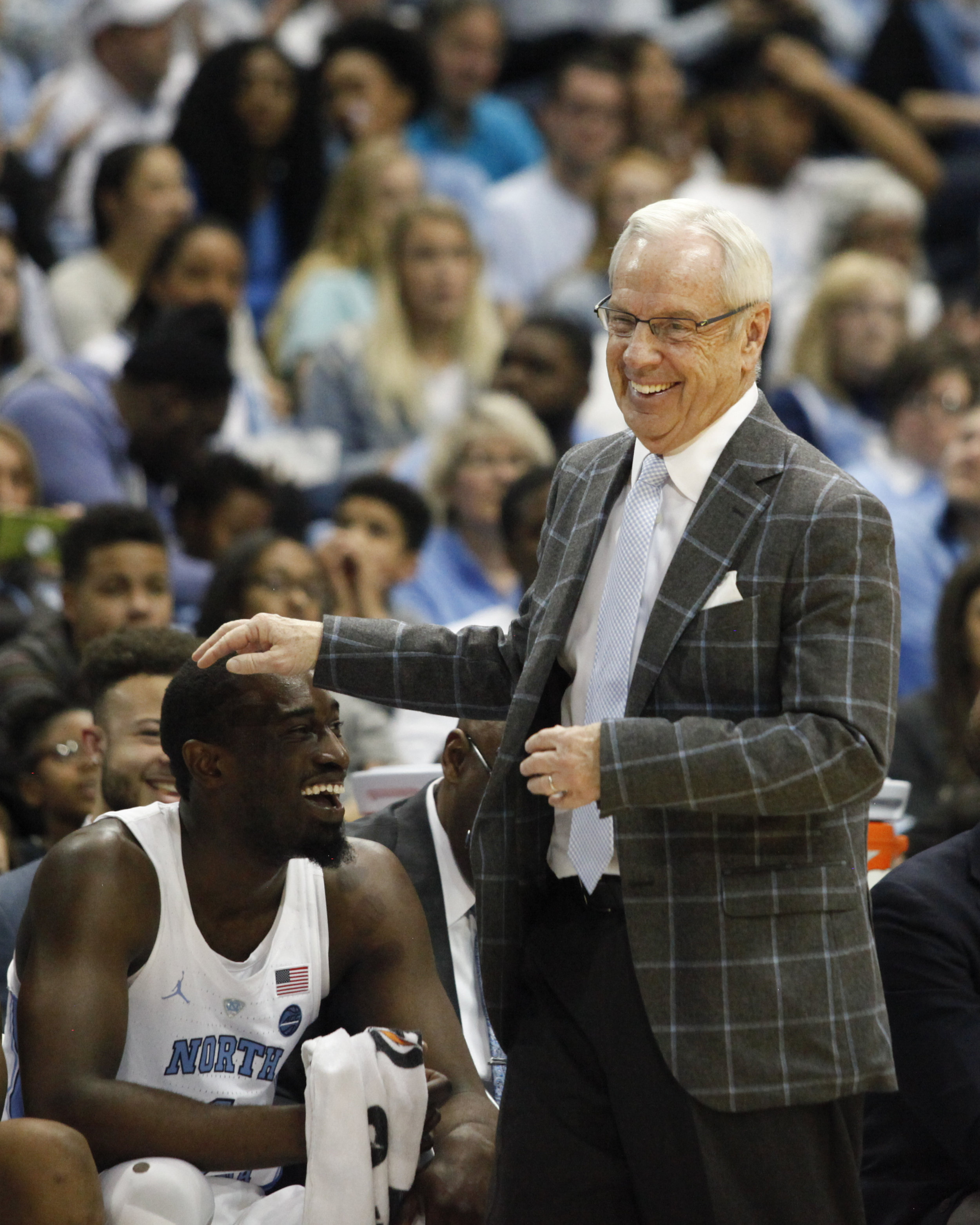 UNC head coach Roy Williams pats senior Theo Pinson on the head during a game at the Dean Smith Center.