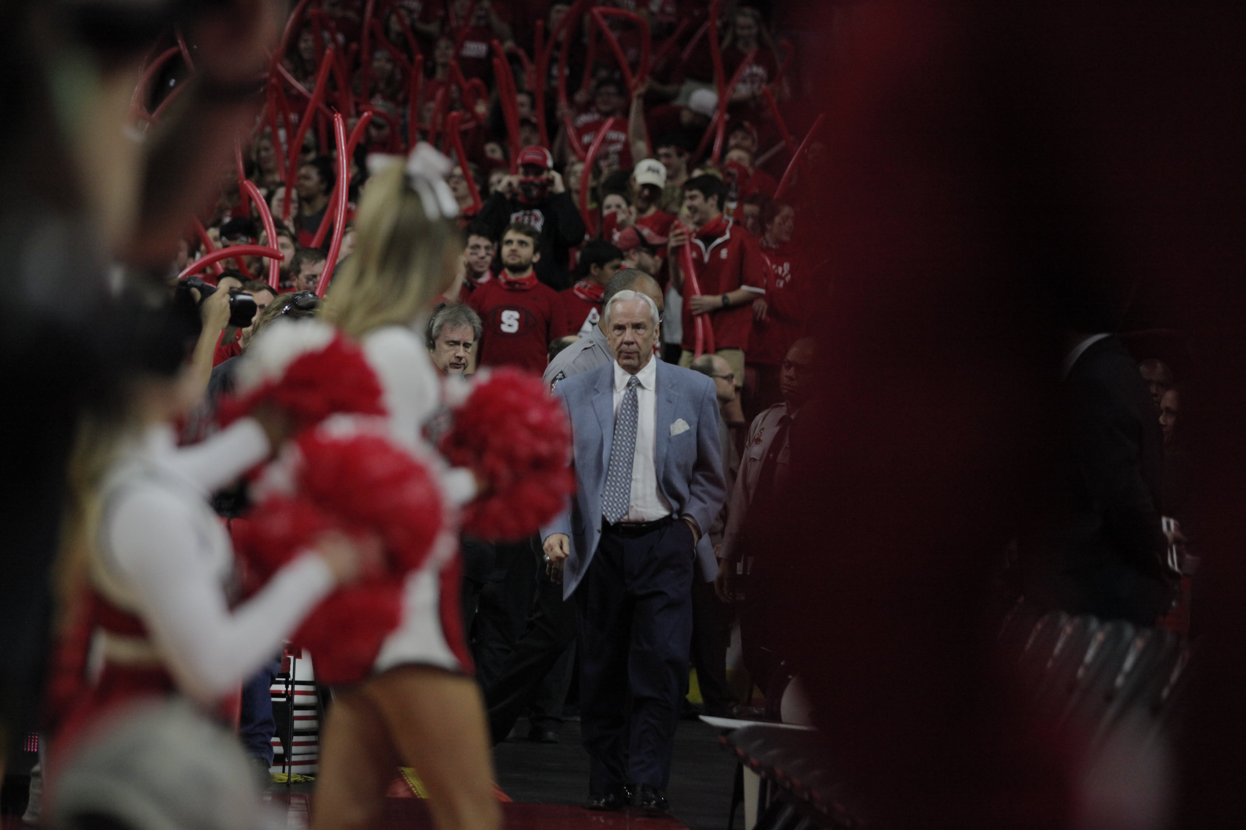 UNC head coach takes the court in a sea of red at PNC Arena ahead of the UNC vs. NC State game.