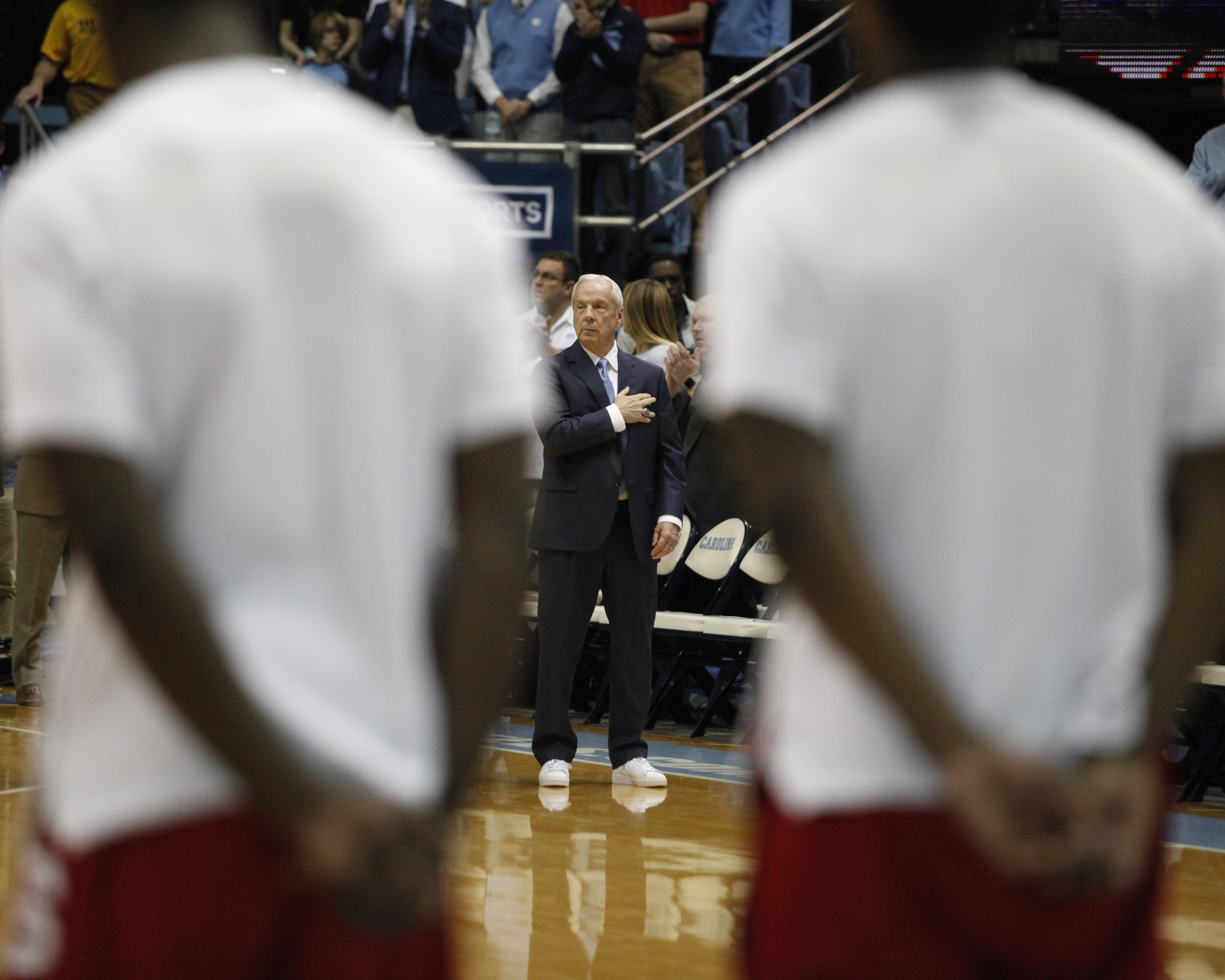 UNC head coach Roy Williams during the national anthem at PNC Arena.