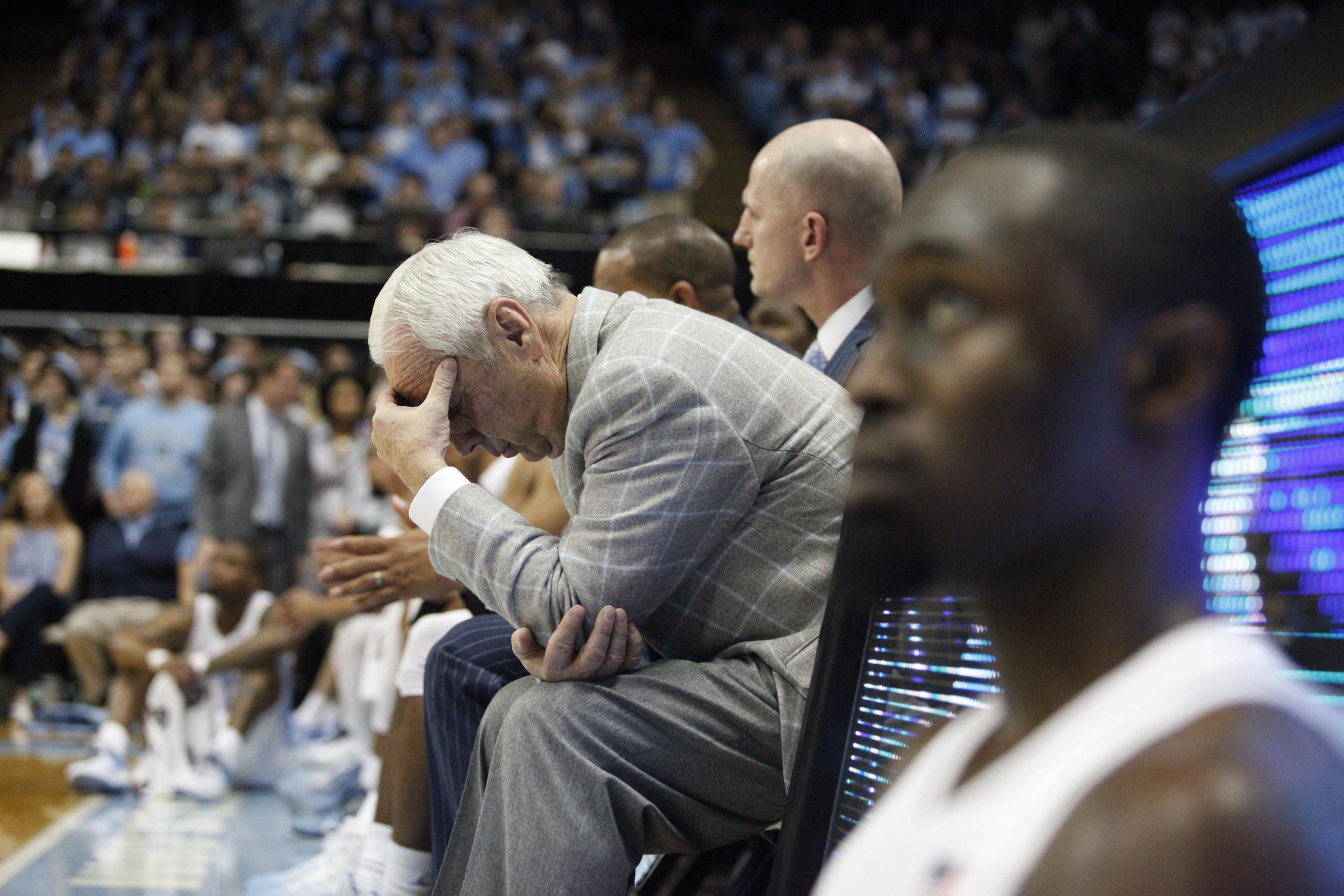 UNC head coach Roy Williams bows his head in disbelief during Senior Night at the Dean Smith Center.