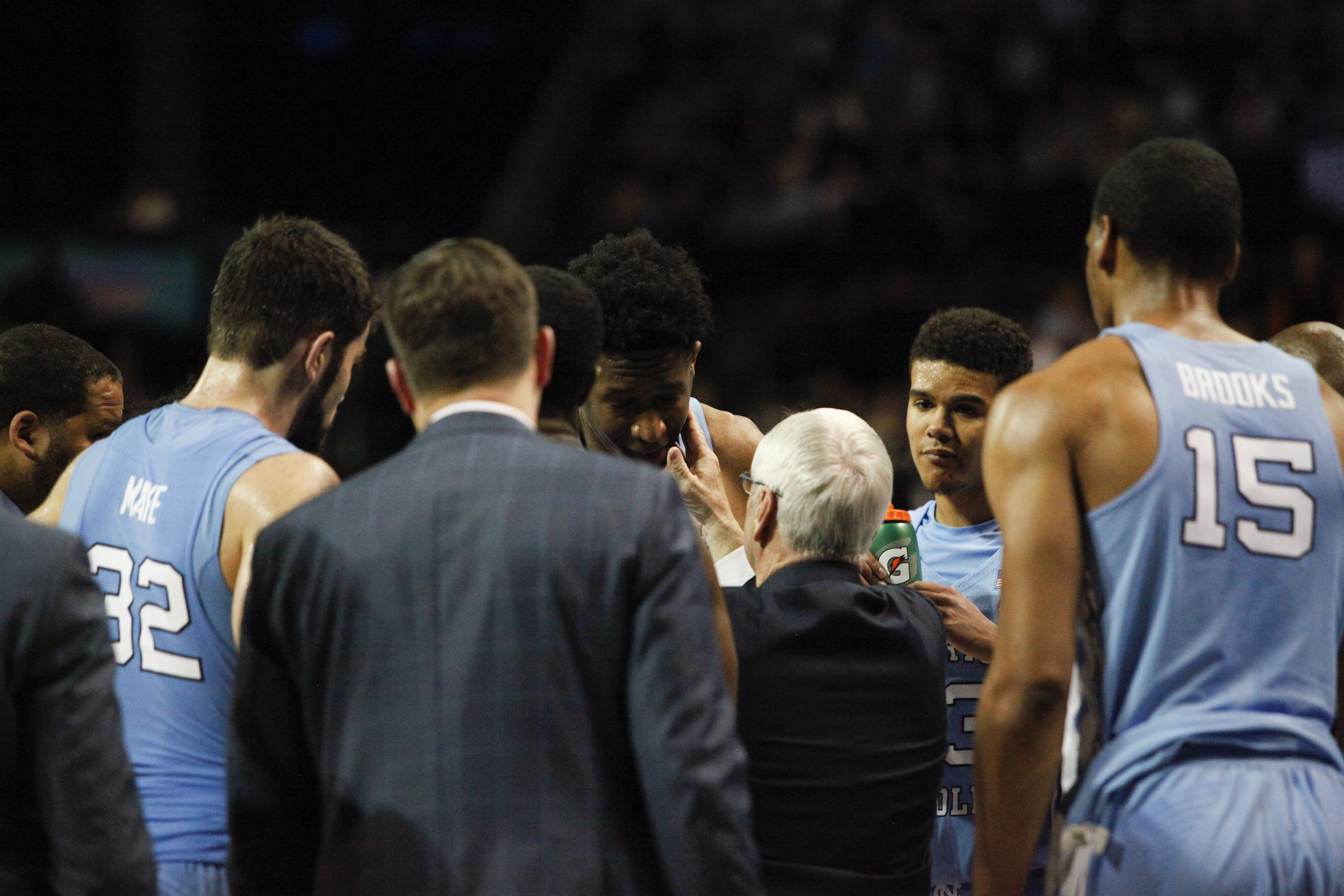UNC head coach gives Sterling Manley a little pat during a huddle in the game against Miami at the ACC Tournament in Brooklyn, New York.
