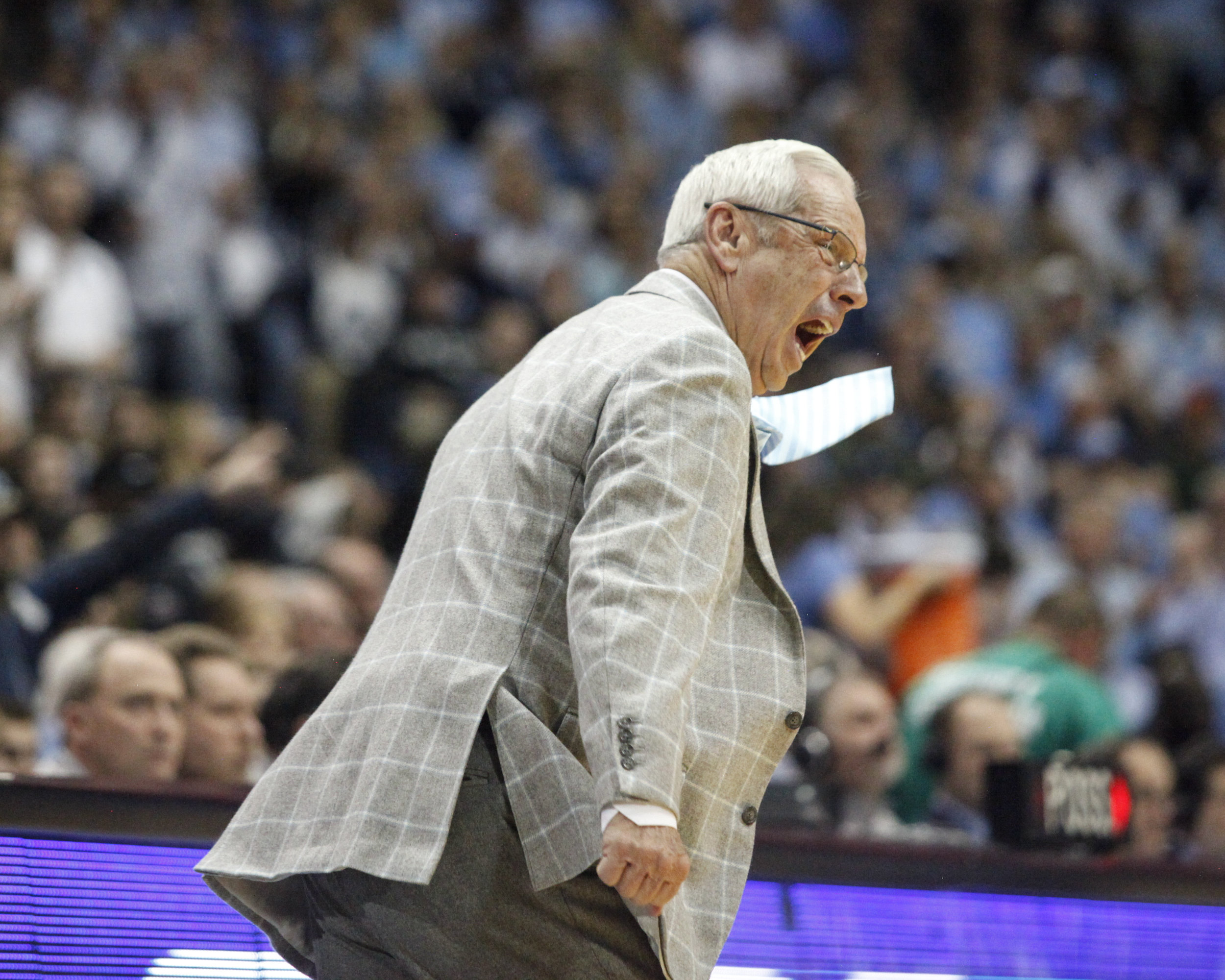 UNC head coach Roy Williams' tie flies as he stomps during the game at the Dean Smith Center.
