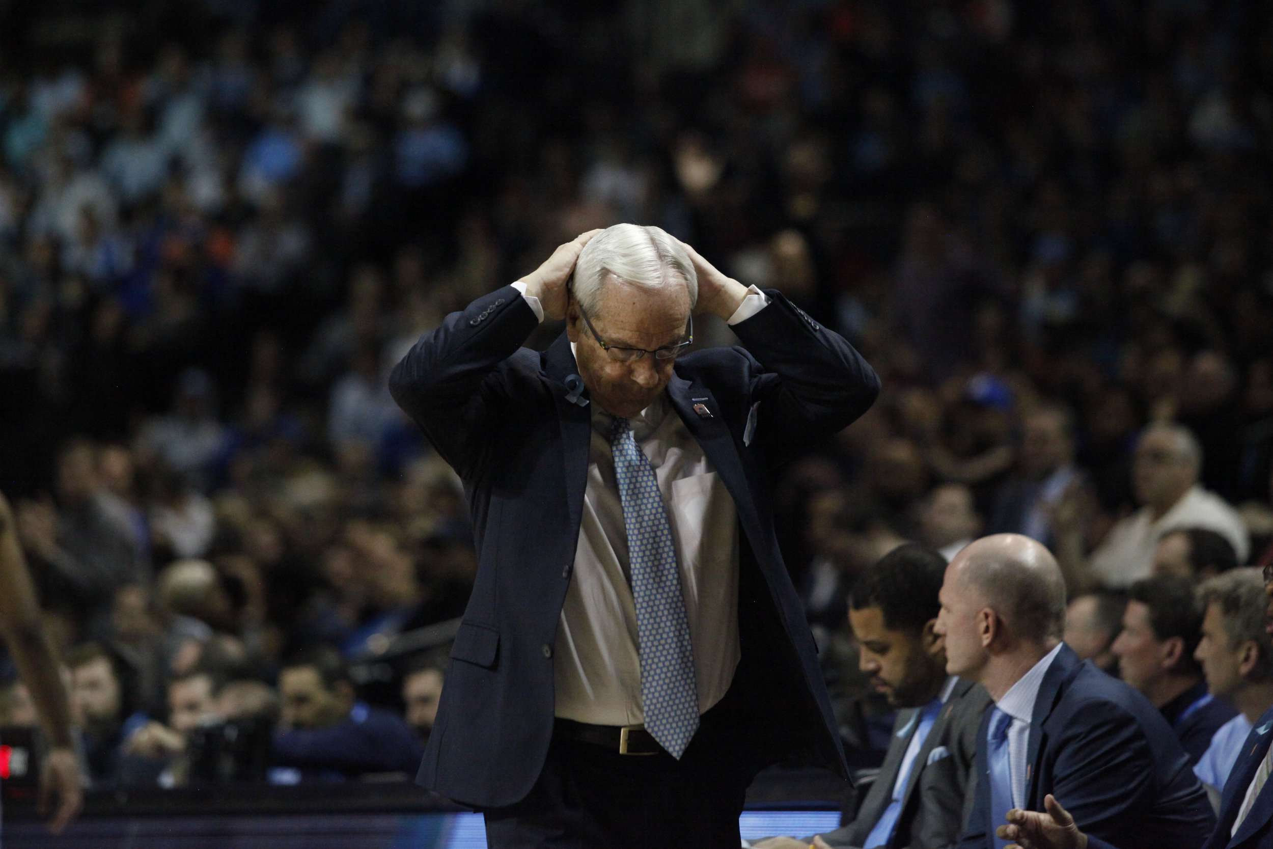 UNC head coach Roy Williams puts his hands on his head as he walks back to his seat during the second round of the NCAA Tournament.
