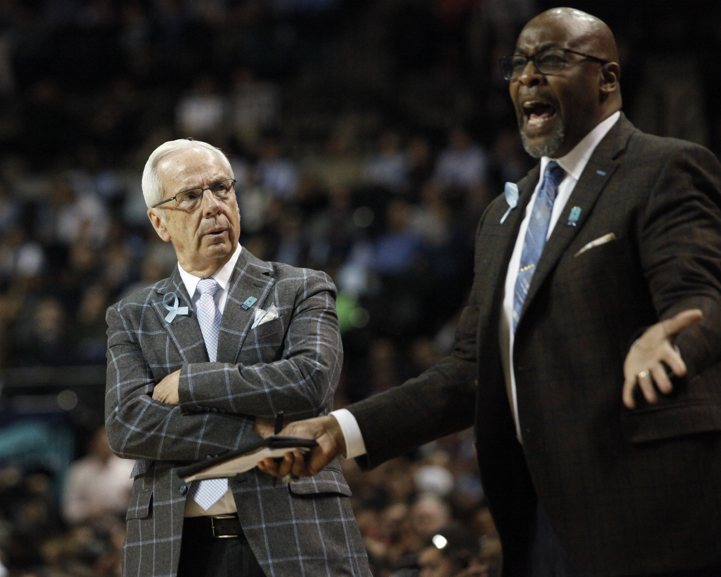 UNC head coach Roy Williams looks at assistant coach Steve Robinson during the ACC Tournament.
