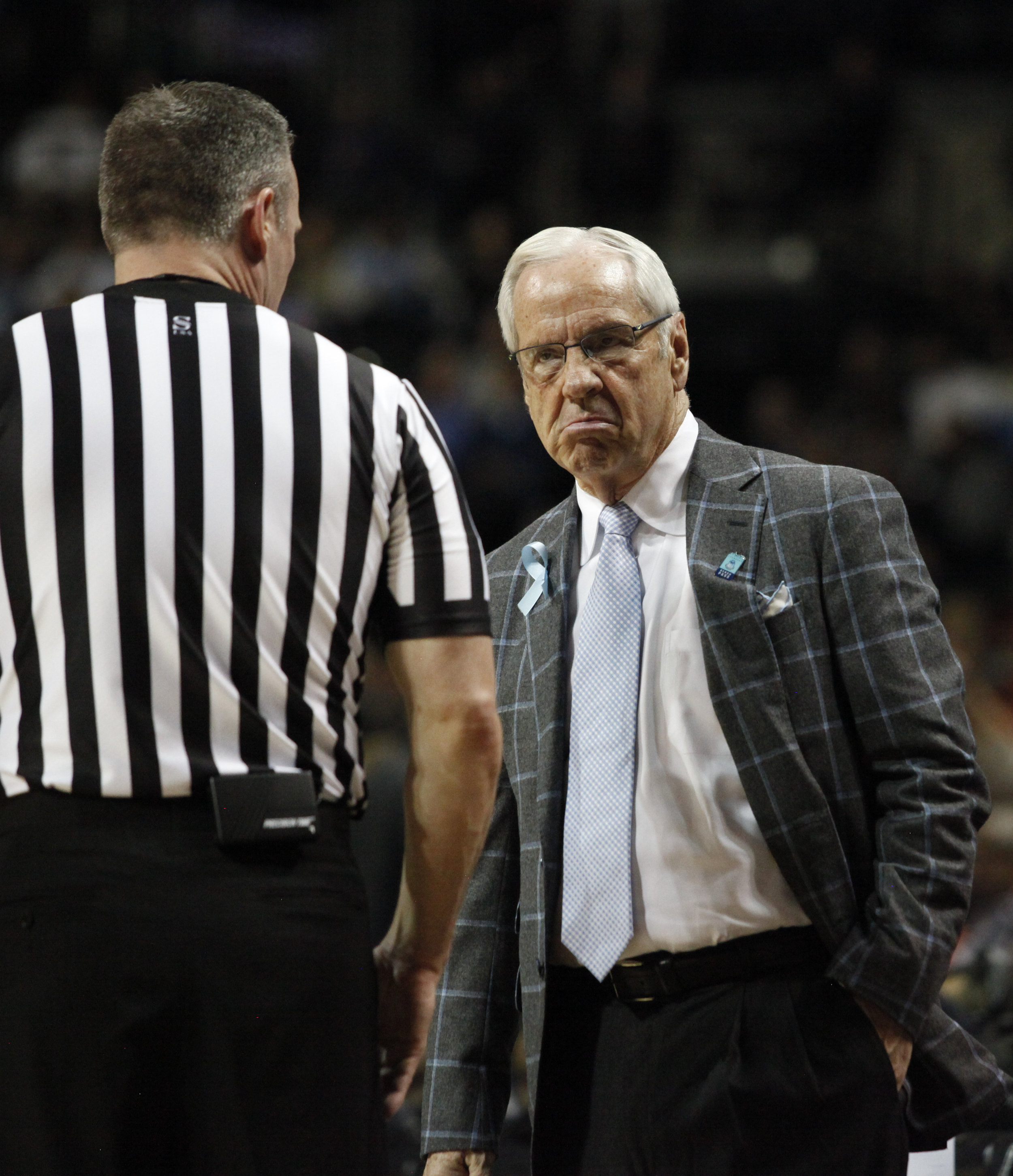 Head coach Roy Williams makes a face at the referee during the ACC Tournament.
