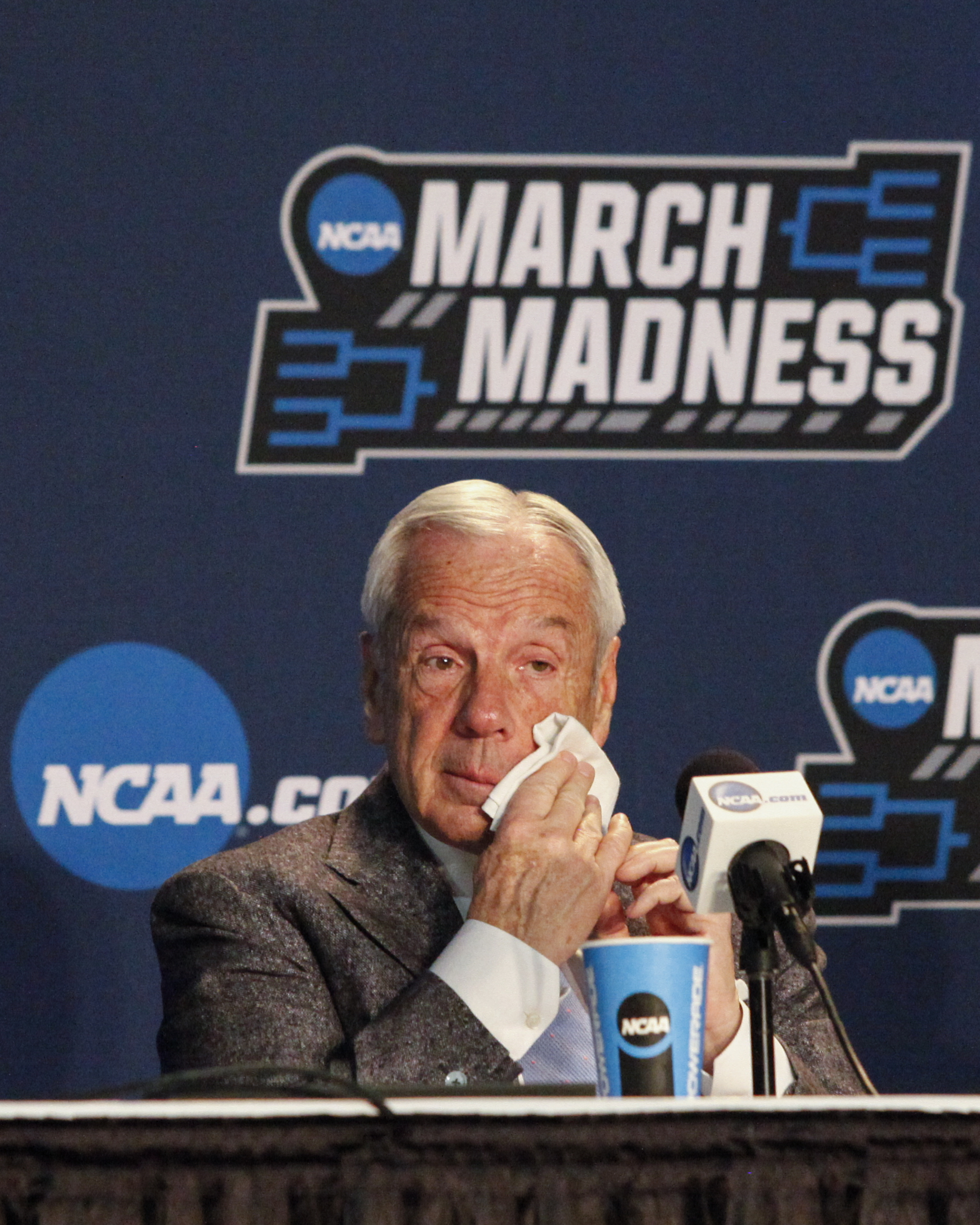 UNC head coach Roy Williams wipes tears from his face as he speaks with media after a loss in the 2018 NCAA tournament.