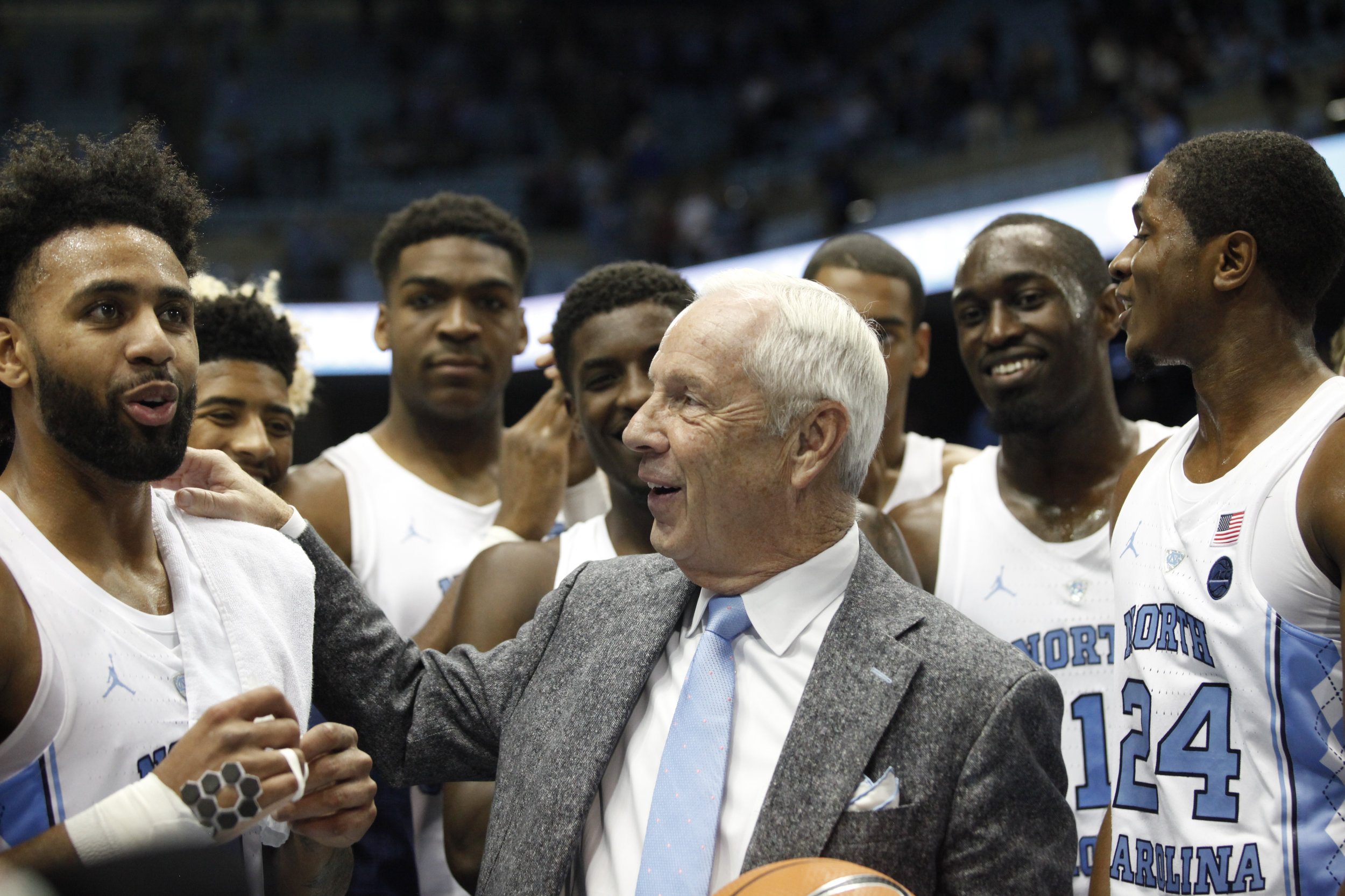 UNC head coach Roy Williams and players celebrate Roy's 1000th win at the Dean Smith Center.
