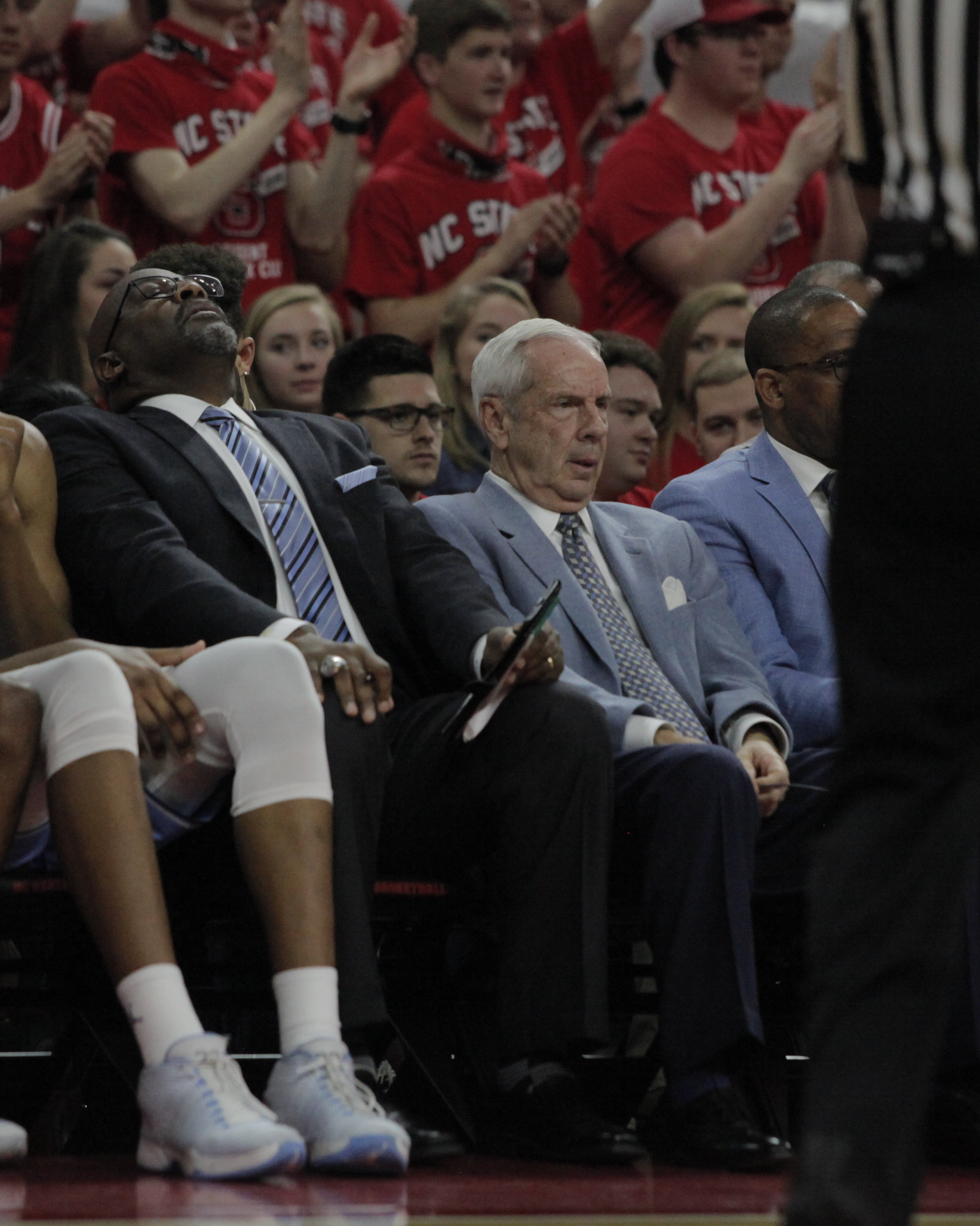 UNC head coach Roy Williams and his assistant coach Steve Robinson lean back in their seats in frustration during the UNC vs NC State game.