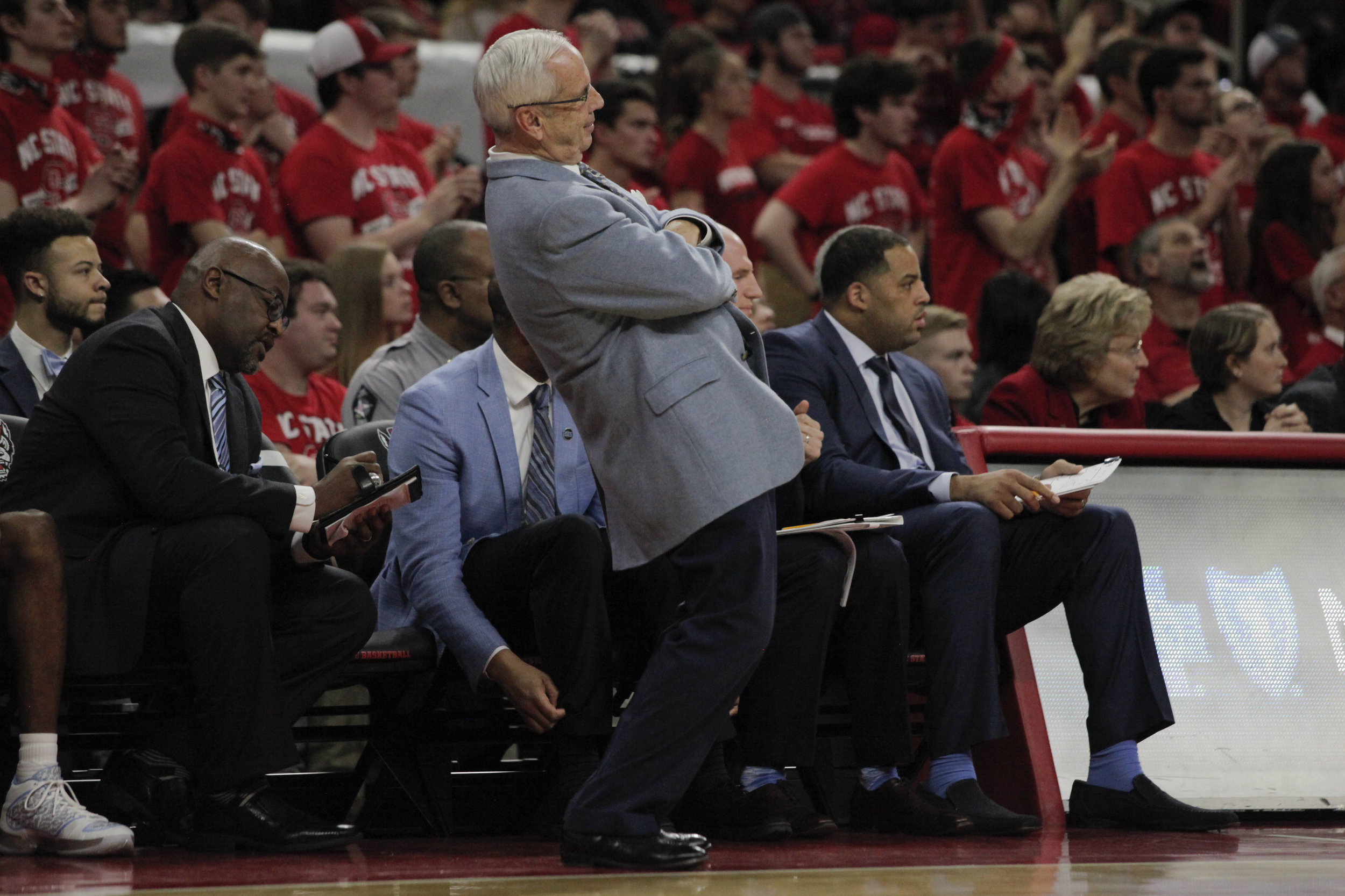 UNC head coach Roy Williams leans back after Theo Pinson misses a free throw during the UNC vs. NC State game at PNC Arena.