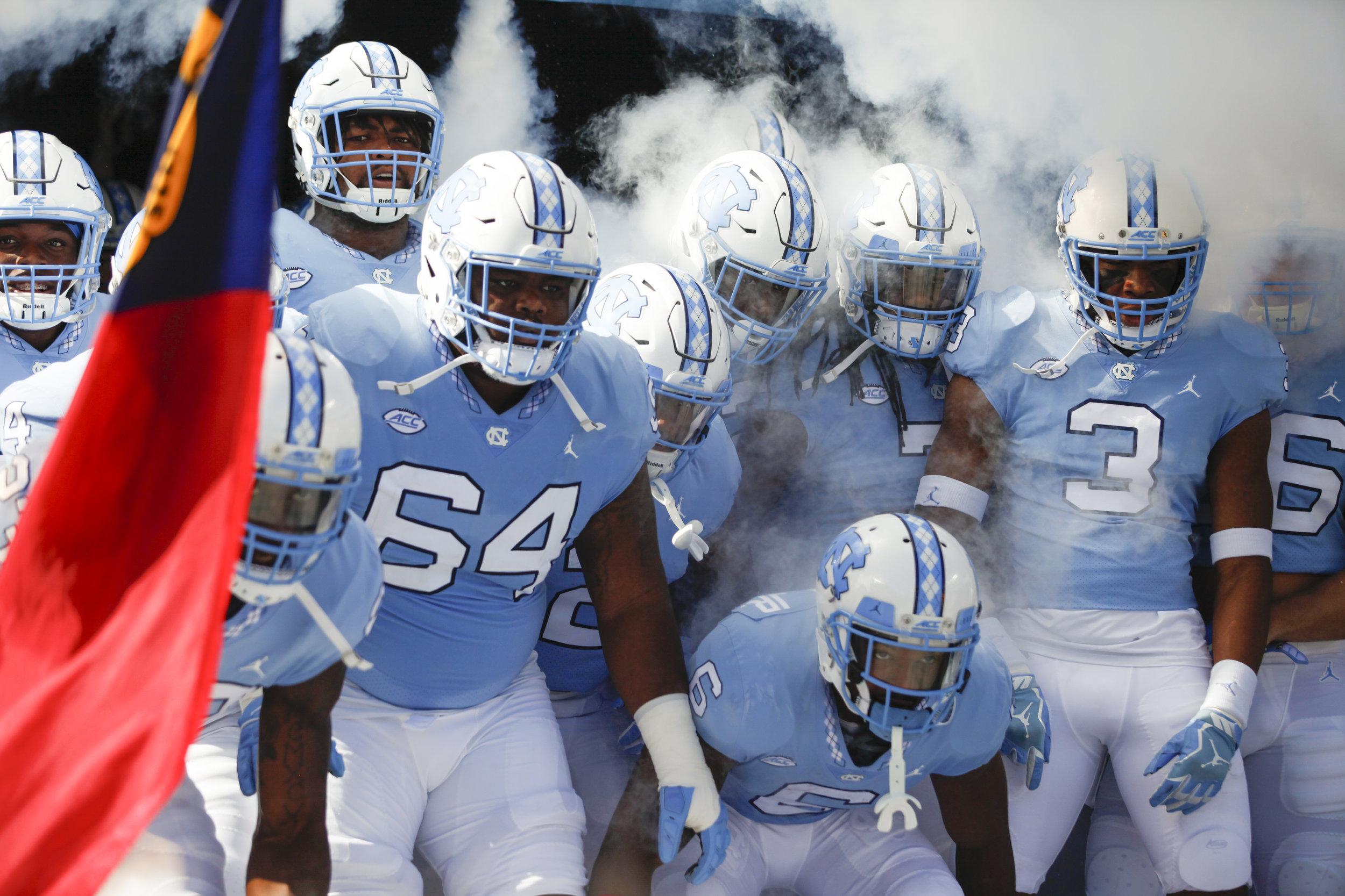 UNC football players prepare to storm the field at the beginning of the 2016 season.