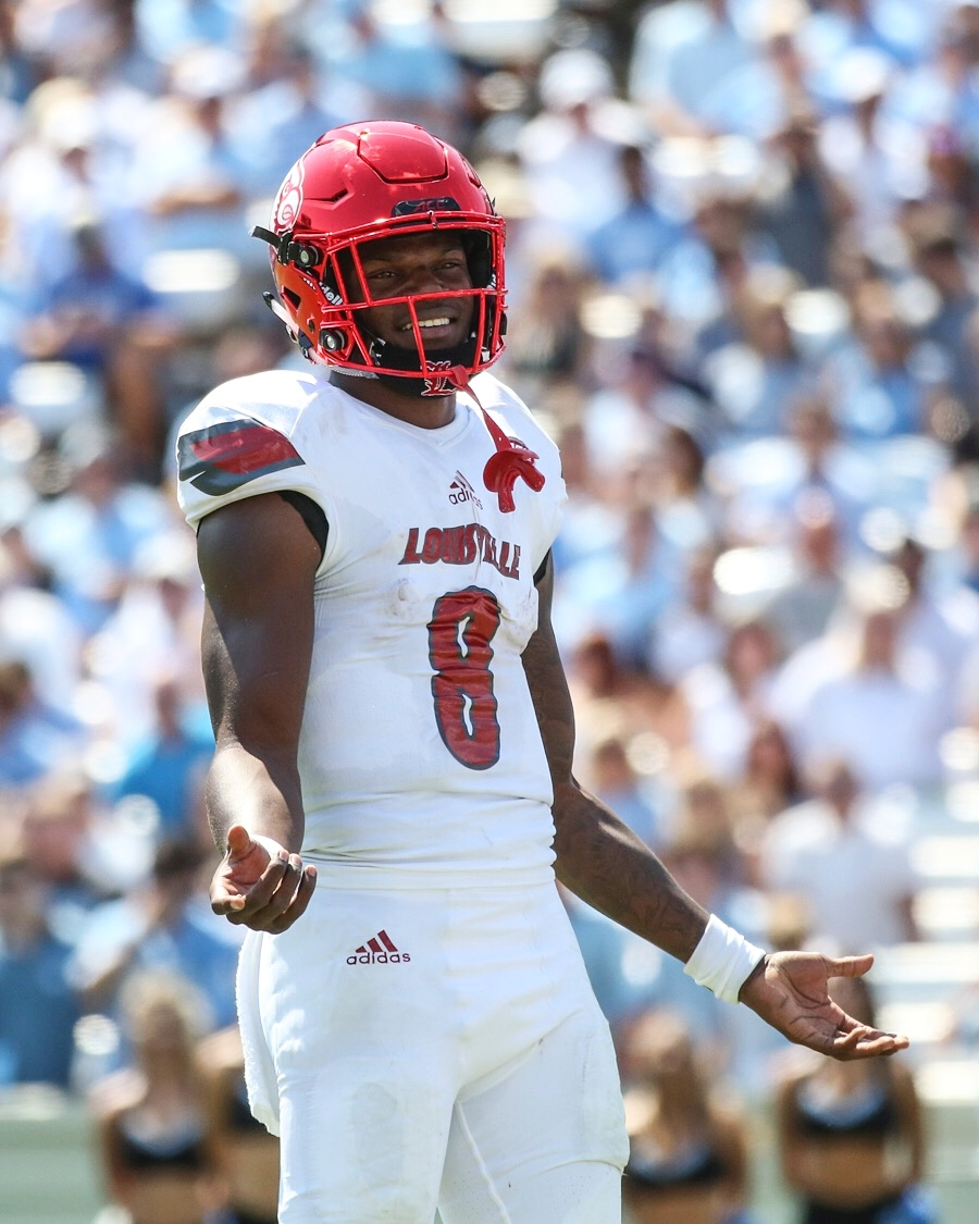Lamar Jackson holds his hands up in disagreement with a call made by a referee during the Louisville vs. UNC game.