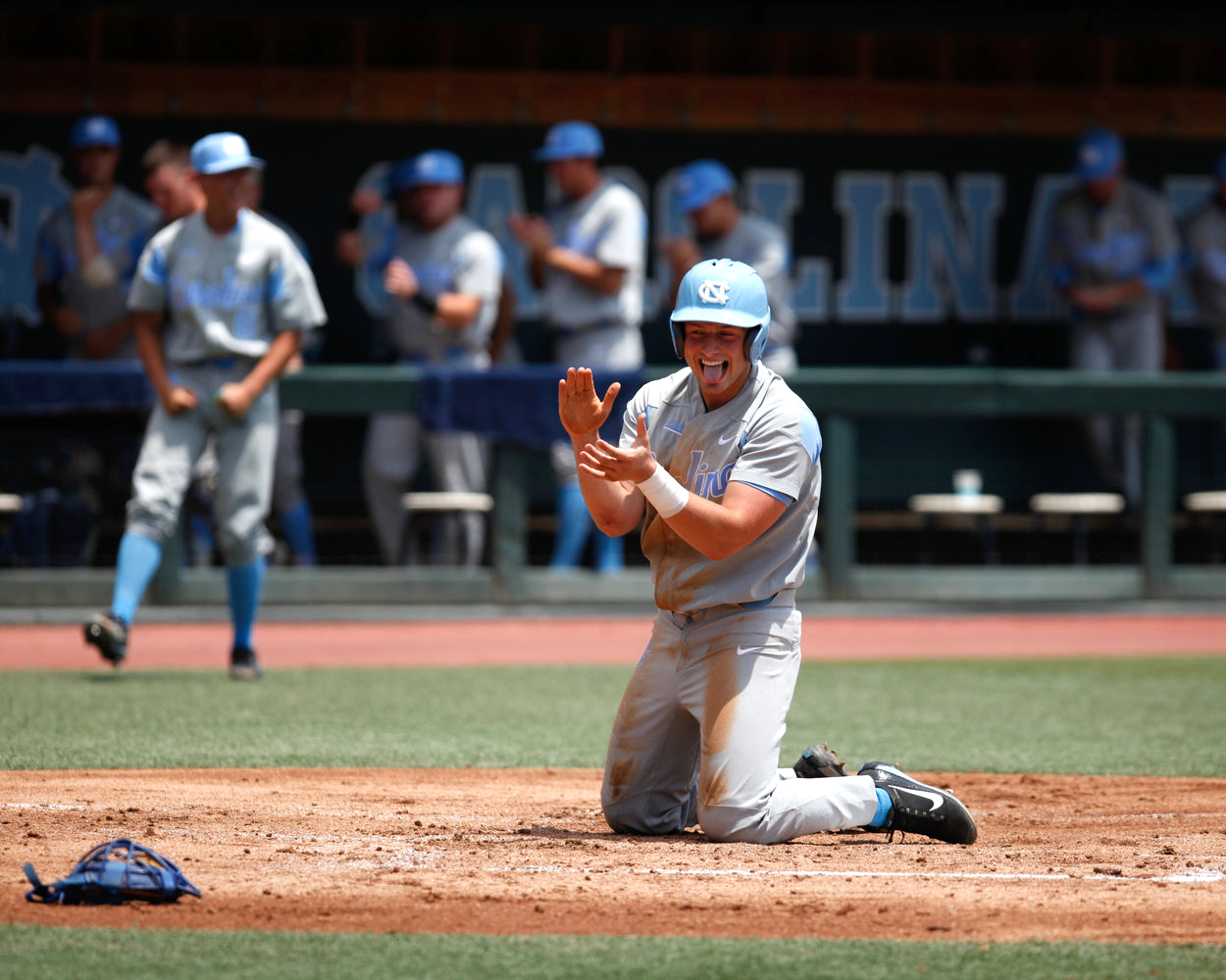 North Carolina freshman Michael Busch celebrates after sliding into home to score during the 2017 NCAA Super Regionals.