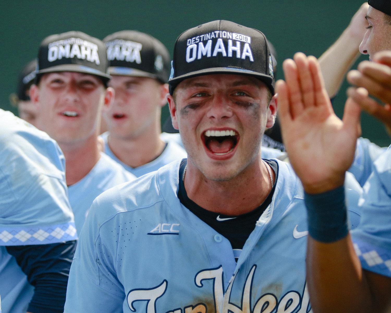Michael Busch celebrates Carolina Baseball's win over Stetson to send UNC back to Omaha.