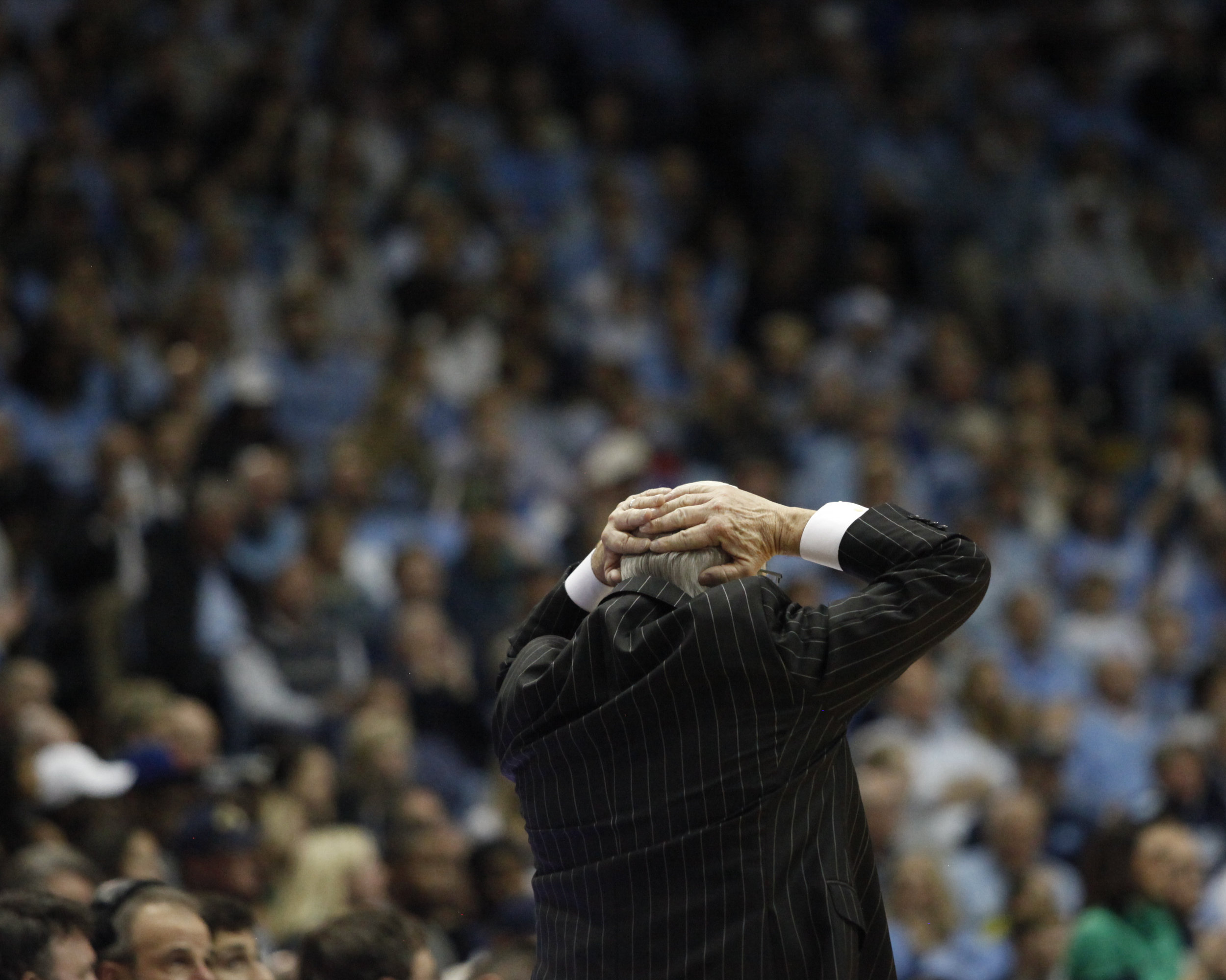 UNC head coach Roy Williams places his hands on his head during a game at the Dean Smith Center.