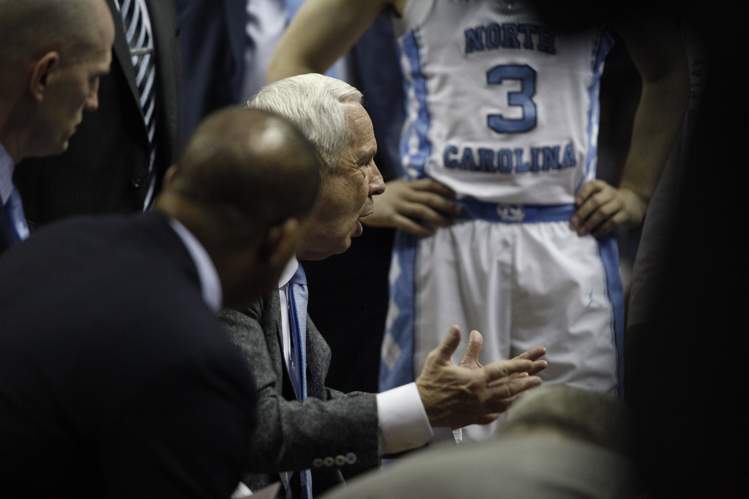 UNC head coach Roy Williams meets with his team in a huddle during the NCAA Tournament.