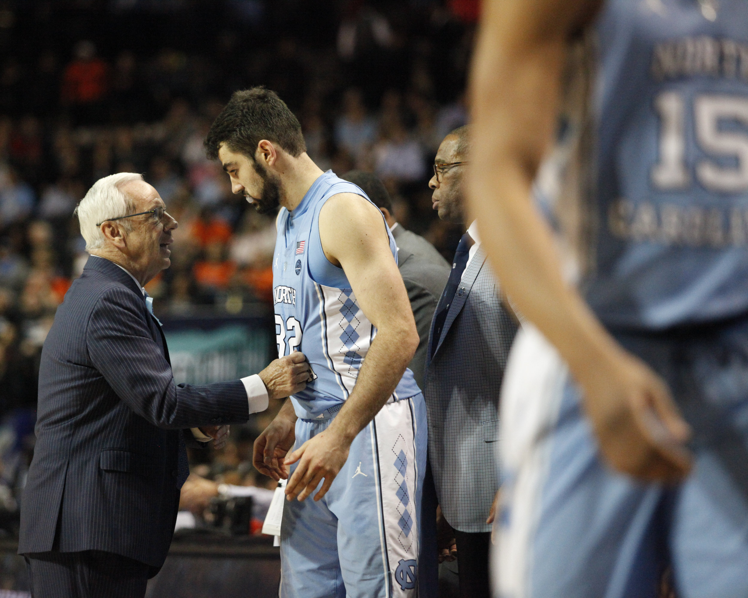 UNC head coach Roy Williams grabs Luke Maye by the jersey to give him a confidence boost during the ACC Tournament.