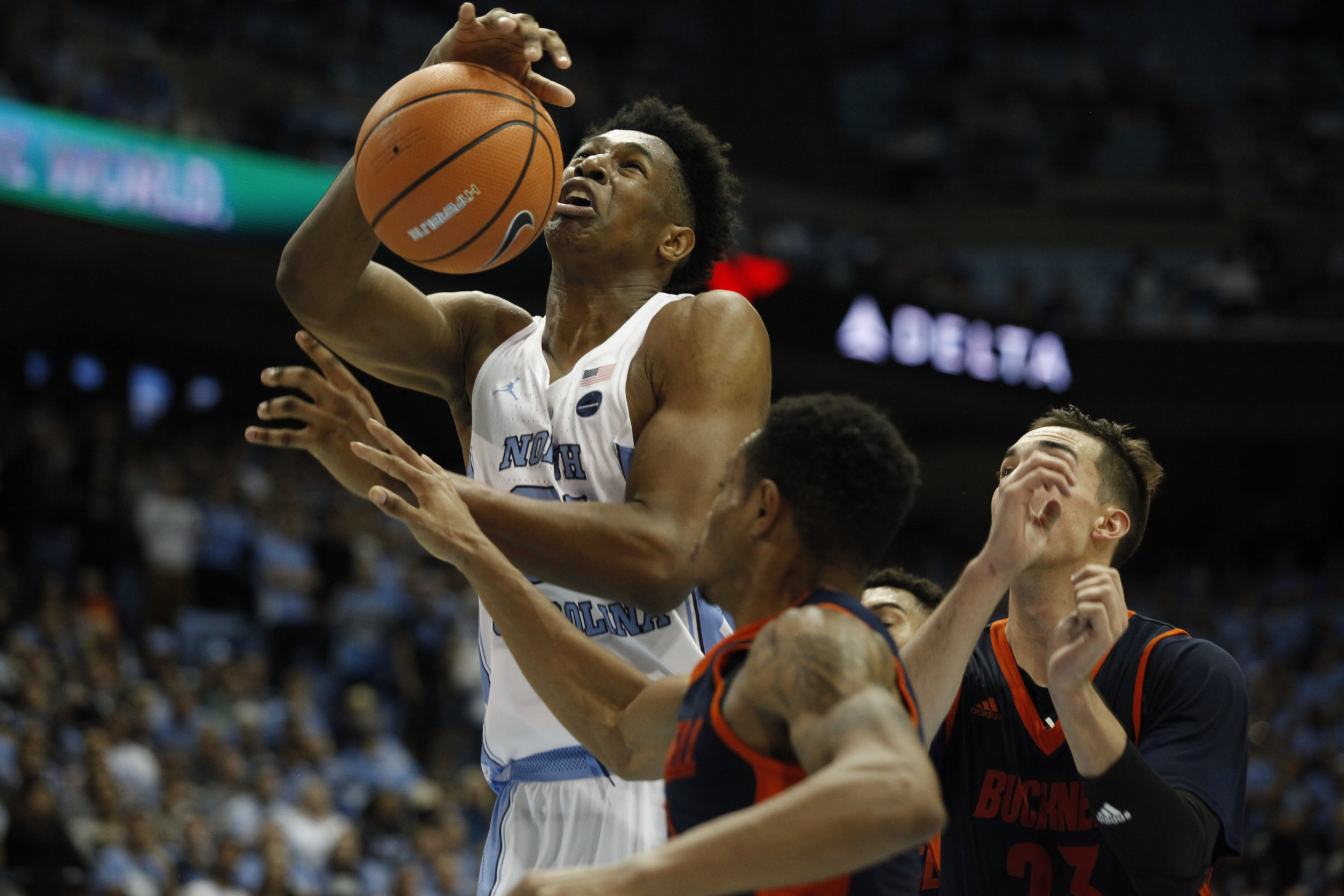 UNC forward, Sterling Manley, is fouled while going up to the basket during the game against Bucknell.