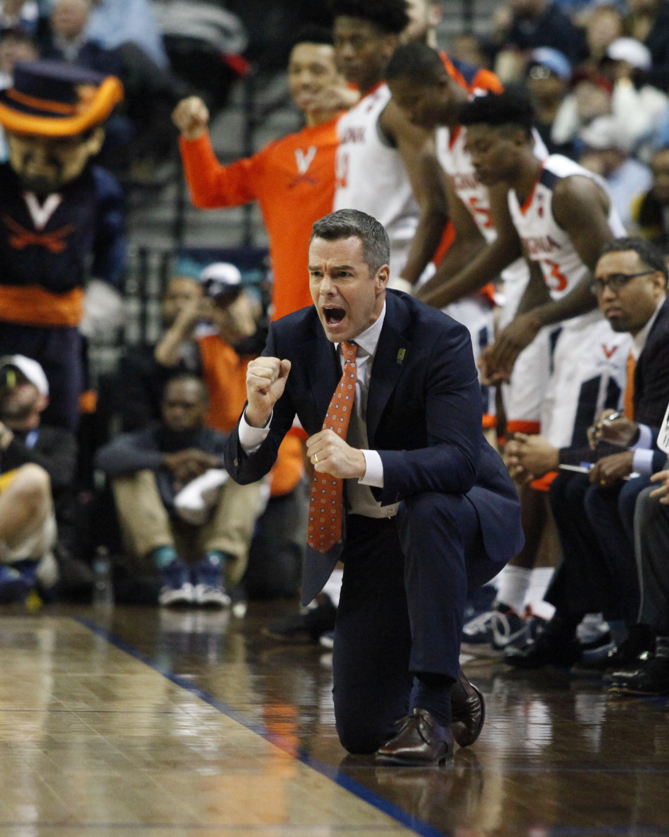 Virginia head coach, Tony Bennett, tries to rally his team during the NCAA Tournament in Charlotte, North Carolina.
