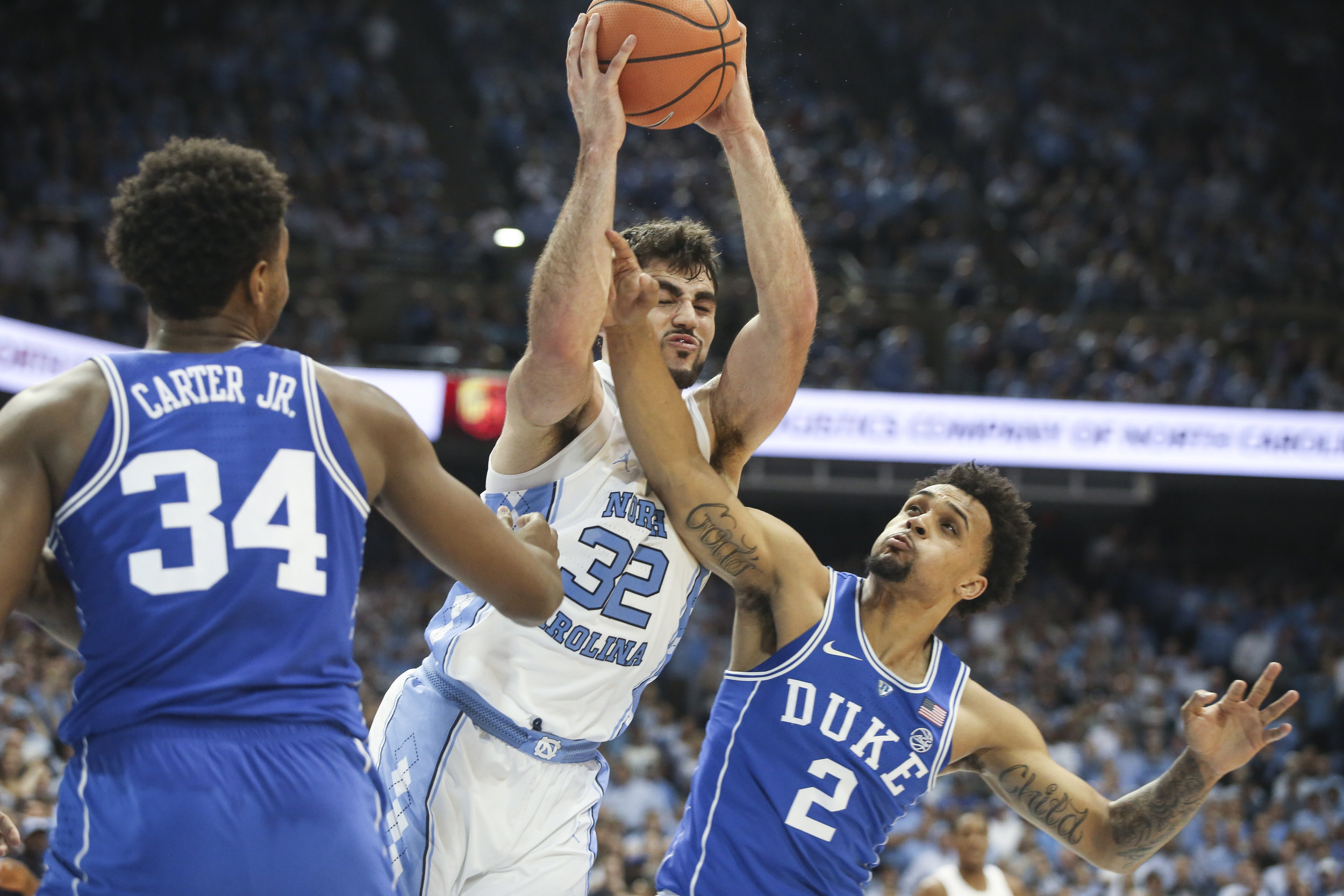 UNC's Luke Maye is fouled by Duke's Tre Duval during the game at Dean Smith Center.