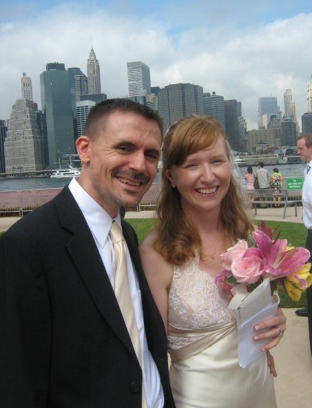 My wife and I, with the East River in the background