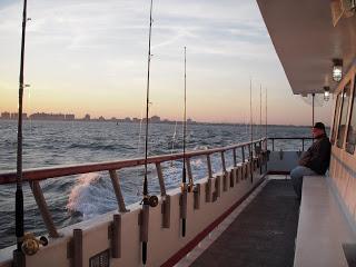 Guy+in+Yankees+Cap+on+Fishing+Boat.JPG