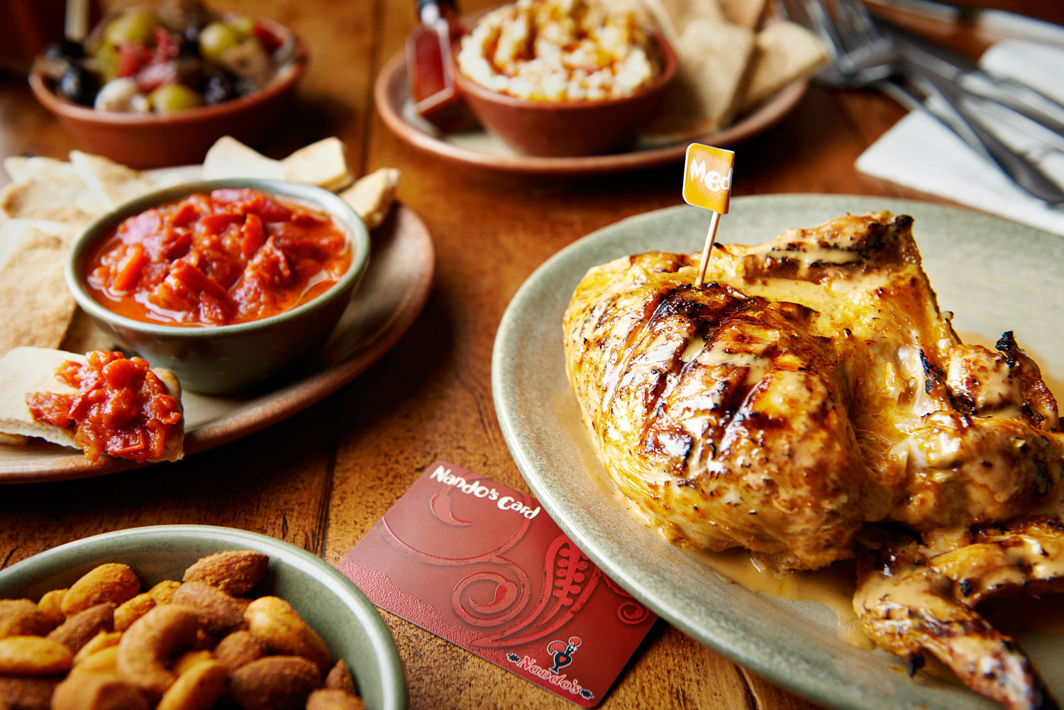 food photography london food photographer london recipe advertising cook book cook editorial packaging design graphic bold bright vibrant lighting lit flash photoshop still life photographer photography still-life still-life restaurant   dinner lunch breakfast meal cooking nando nandos nando's chicken  quarter half whole sauce grilled flame fried plate platter pita pitta dip red pepper salsa nuts olives table selection
