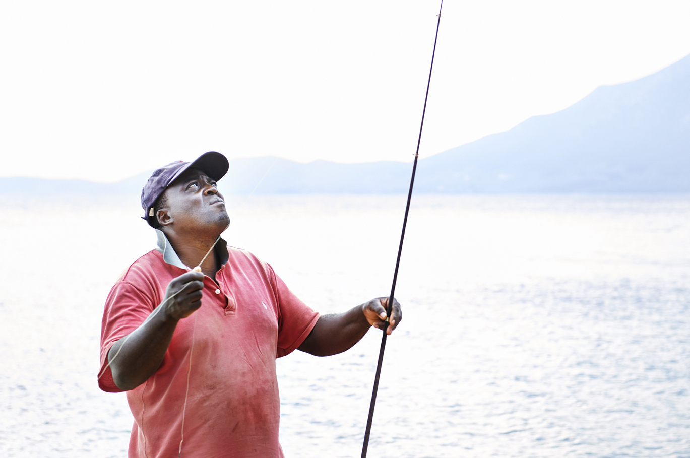 Ernest fishing rod fish fisherman hat shirt baseball t cap pink homemade sea mountains landscape overexposed over exposed  silver island photography photographer food photographer london britain uk recipe cookbook cook book ingredients travel greece sunshine bright vibrant delicious tasty method trees rustic daylight