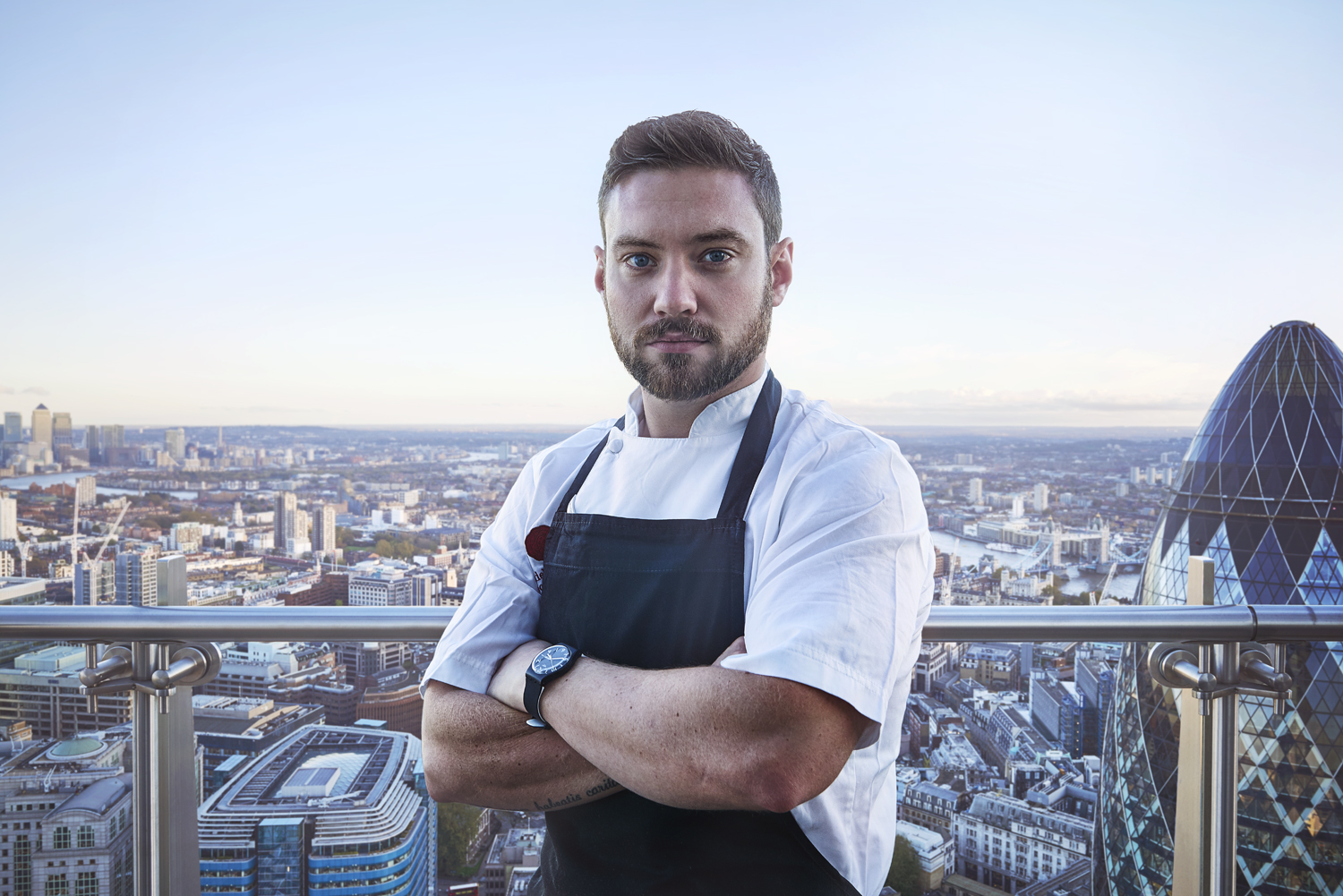 Dan Doherty - The Executive Chef at the Duck & Waffle in East London. He's shown hereon the Duck & Waffle's 40th floor balcony.