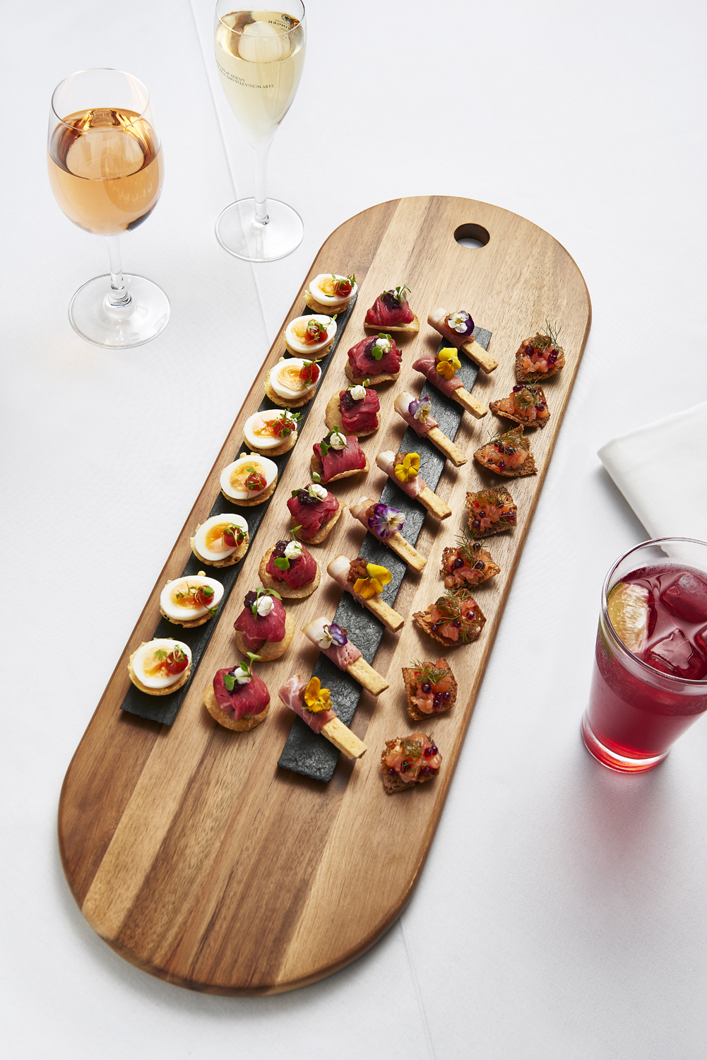 Food photographer by London food photographer Scott Grummett. Shooting for Bafta. Images of Canapés on sharing platters with drinks. Beef, eggs, ham and Salmon