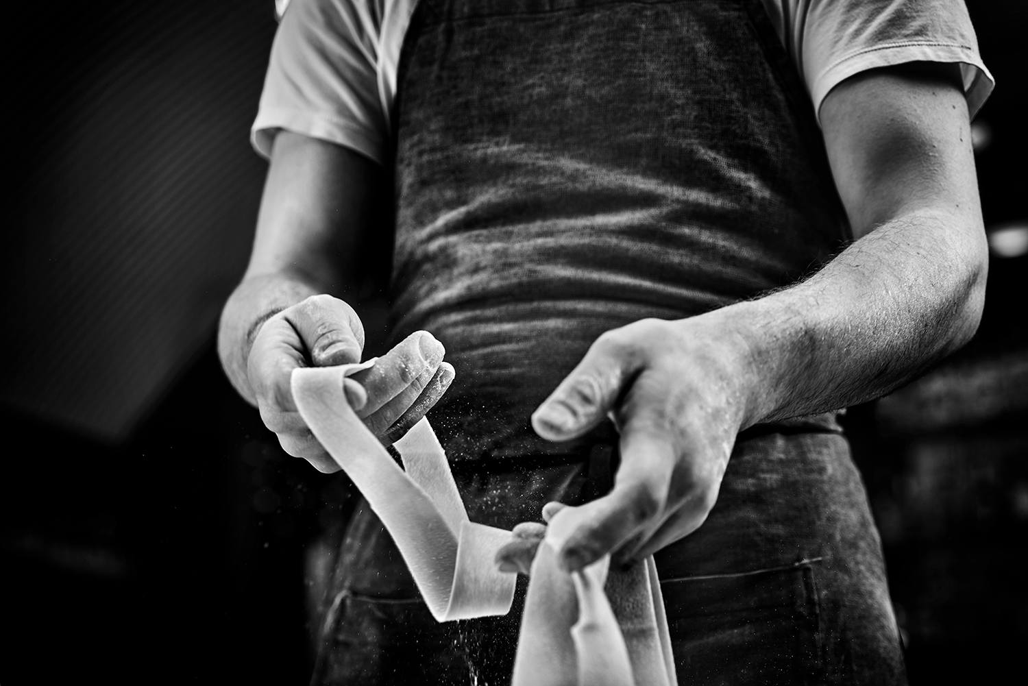 food-photographer-photography-drink-pasta-recipe-recipes-hand-made-fresh-prepared-documentary-provenance-cooking-cook-cookbook-recipe-making-process-steps-step-by-step-black-and-white-hands-hand-cutter-cutting-tool-tools-tortellini-tortelloni-lasagne-tools-pasta-making-overhead-brass-cutter-roller-brush-extruder-press.jpg