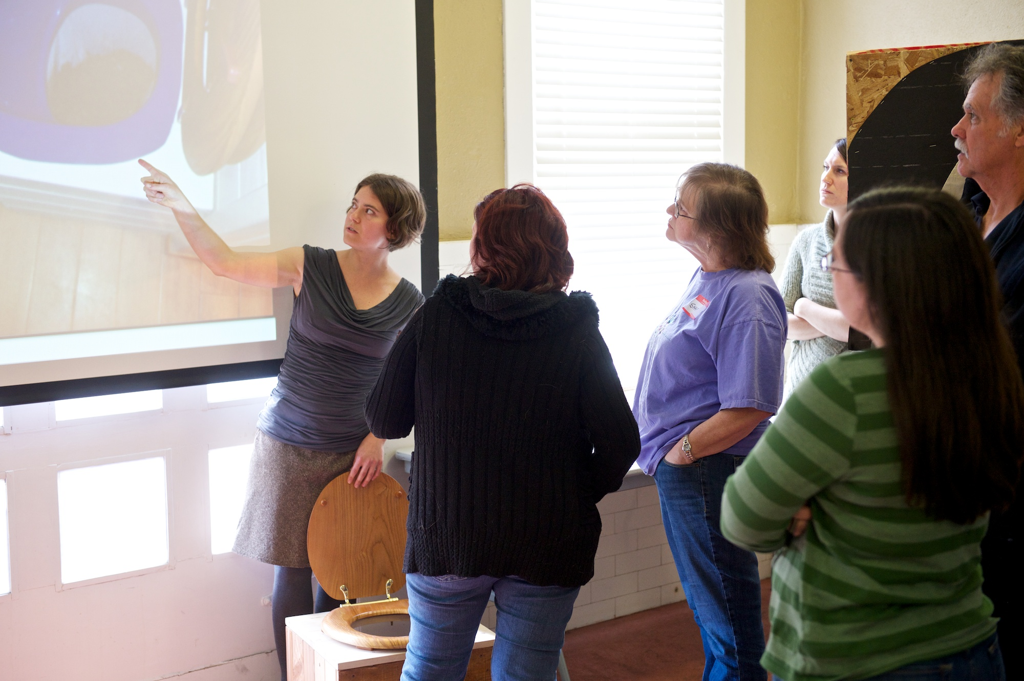 Lina doing a little potty talk as she educates on how to properly work with your composting toilet system.