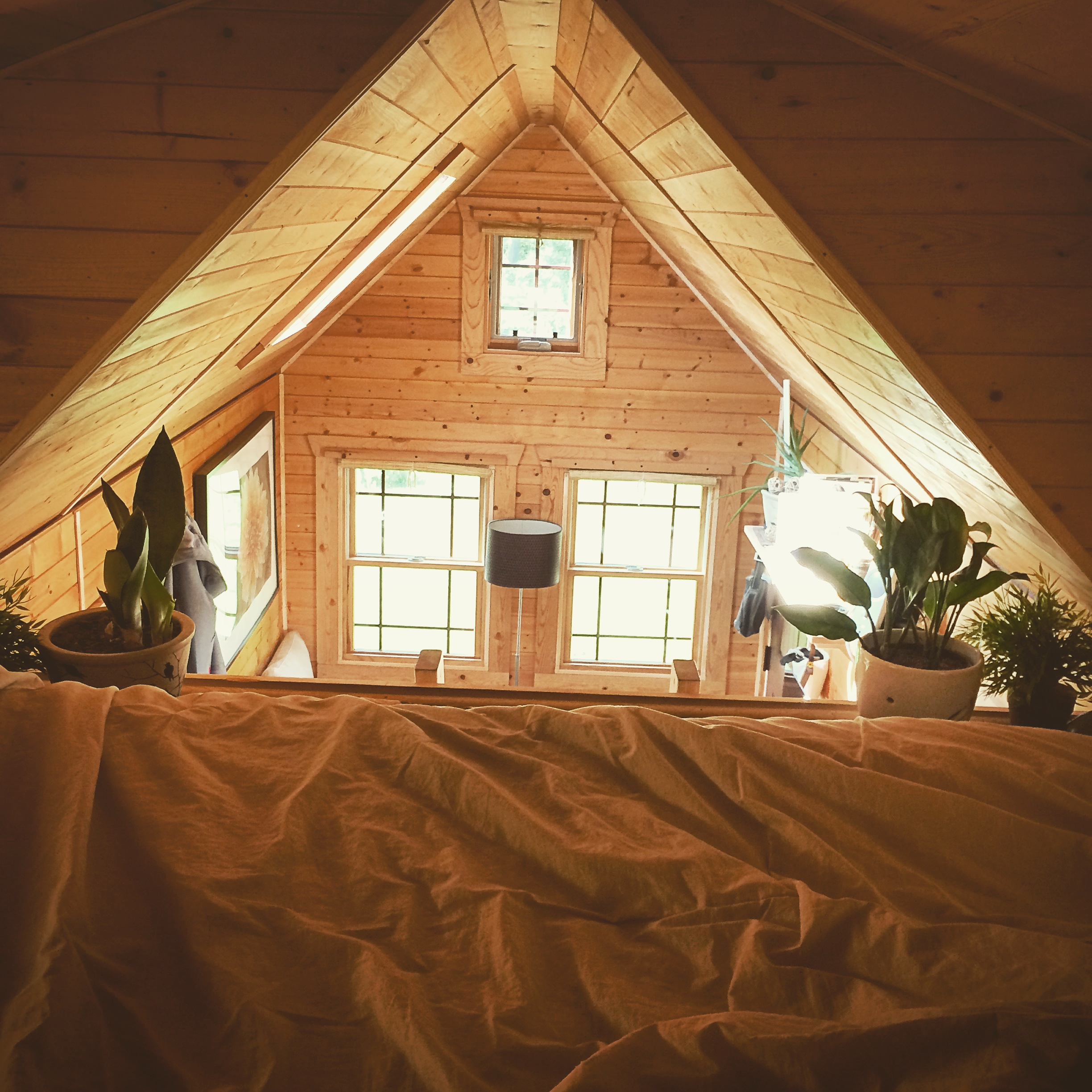 I will never get over how cozy my loft is! Even if it's 90 degrees up there... I will still take a nap! I'v considered painting my walls white at one point, but I'm happy with they way they are right now. The warm glow just punches the cozy up another level!