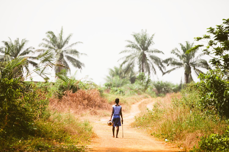 Pregnant Liberian woman with machete