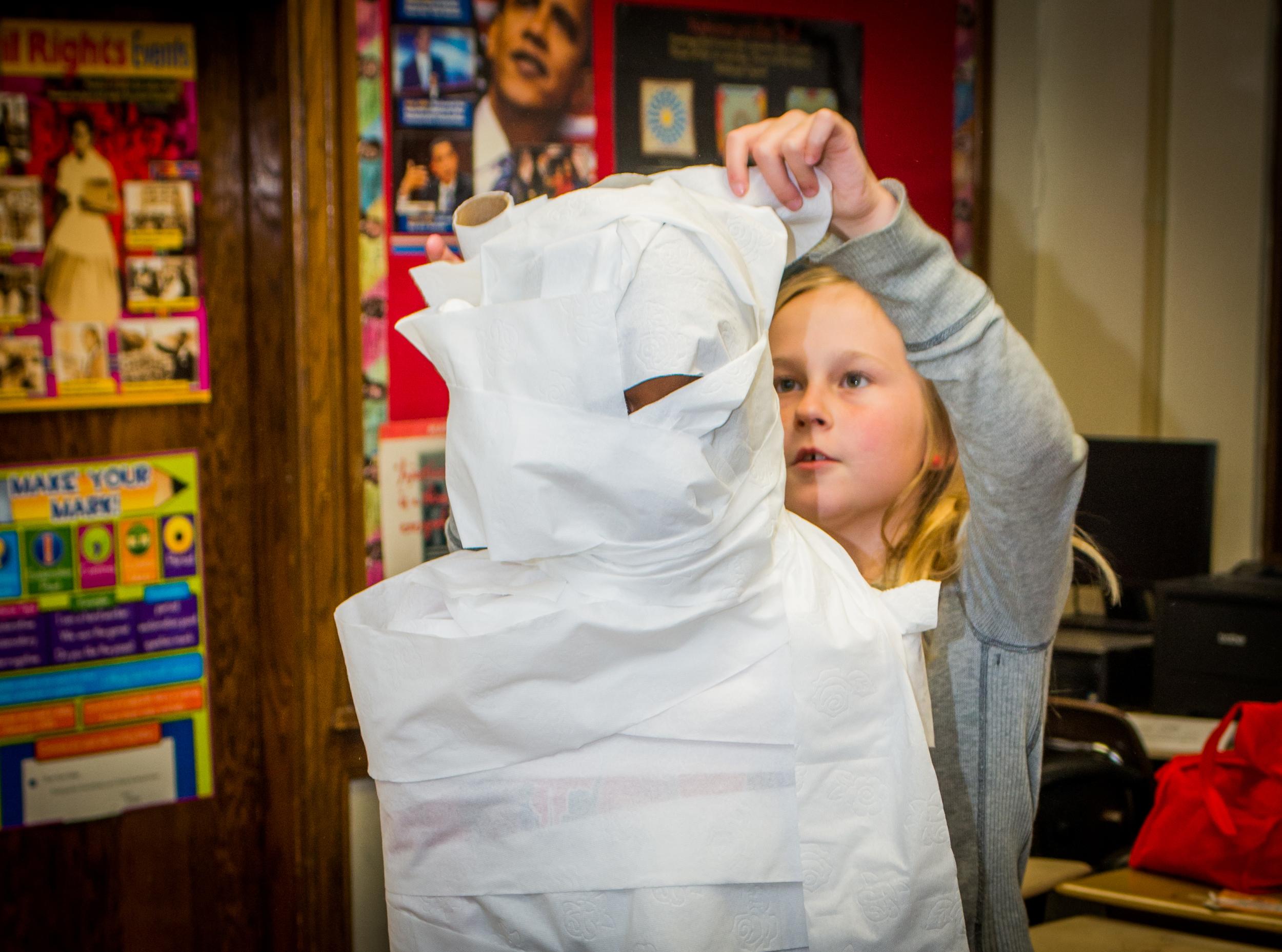 Mia making a mummy