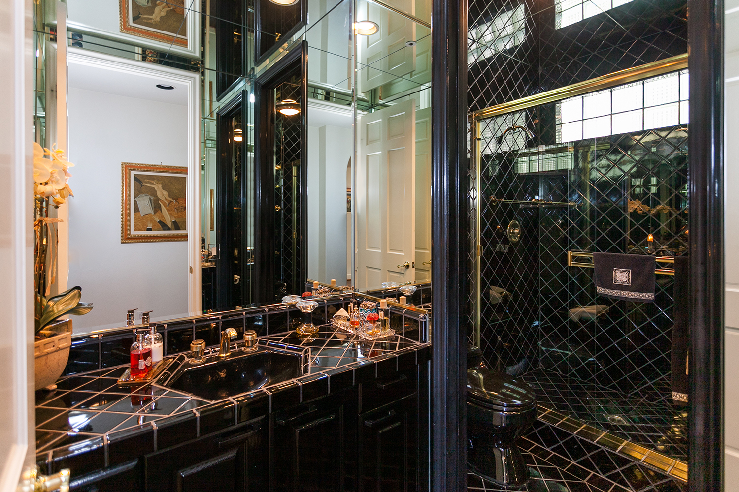 We love this black and gold bathroom!