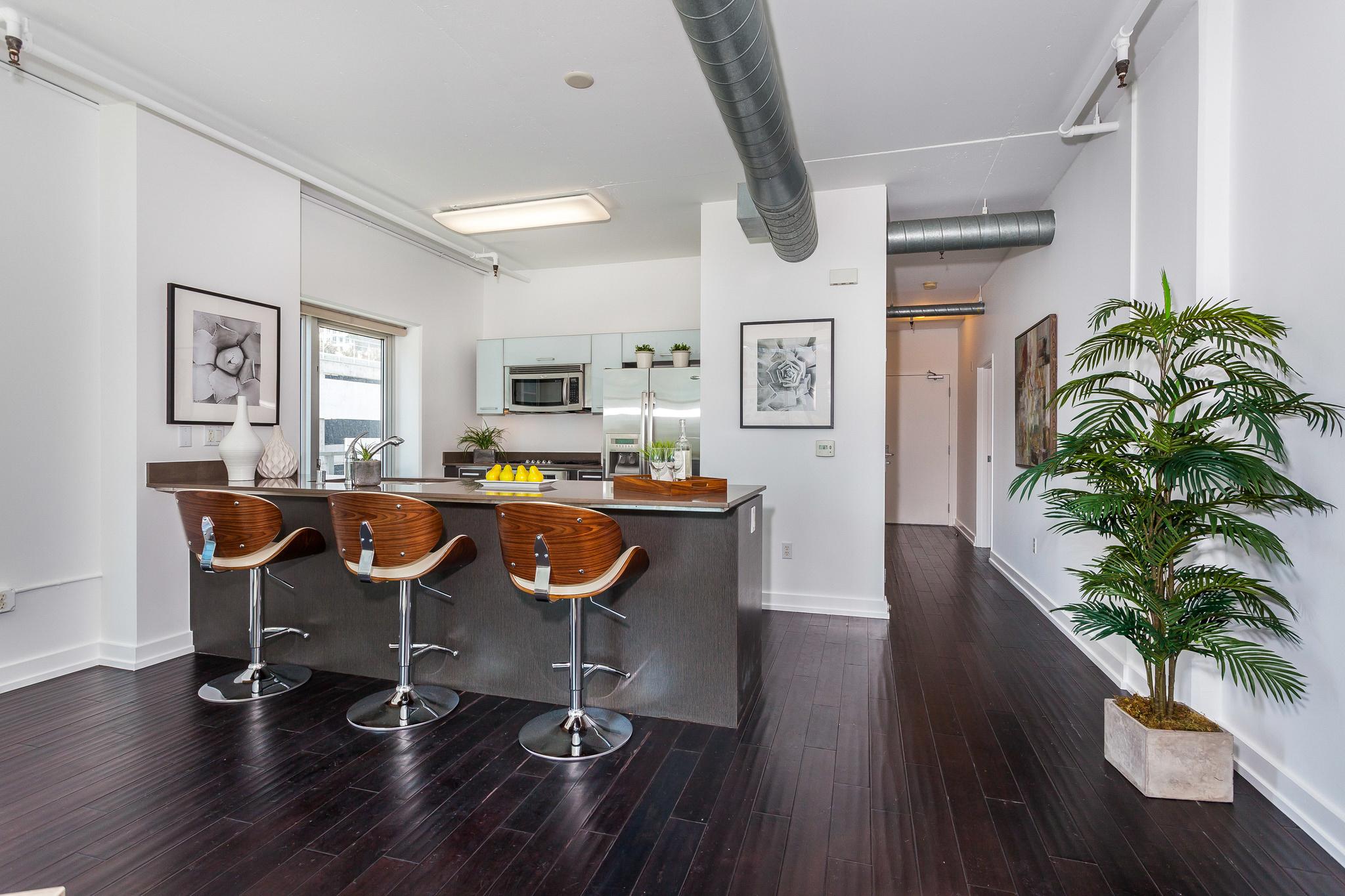 kitchen bar with front door beyond