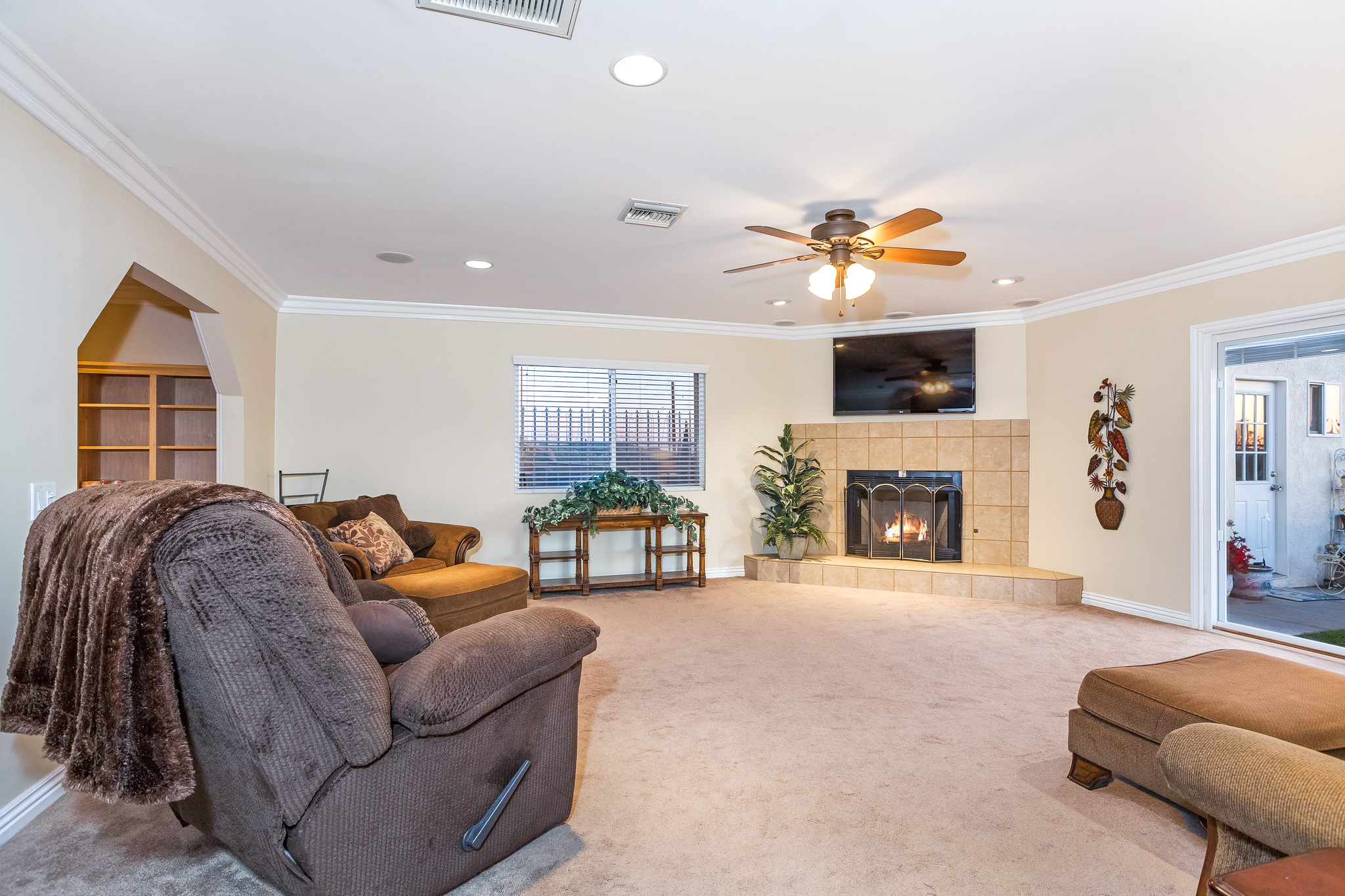reverse view of family room with fireplace