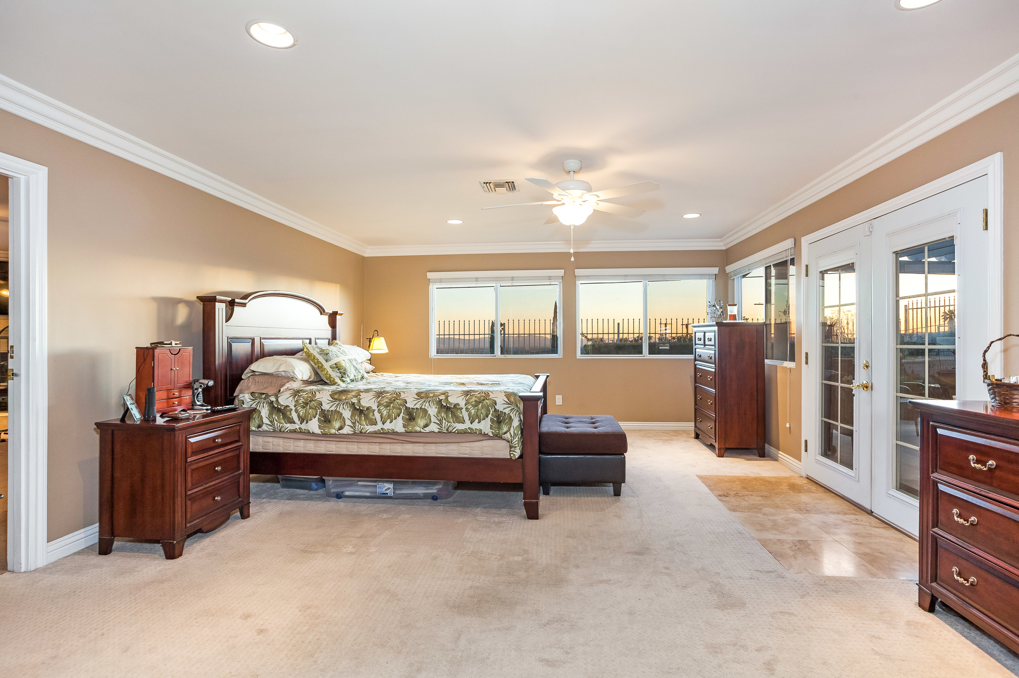 view of master bedroom with windows on far wall
