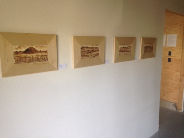 View of shared hallway in new studio with my walnut ink painting series.