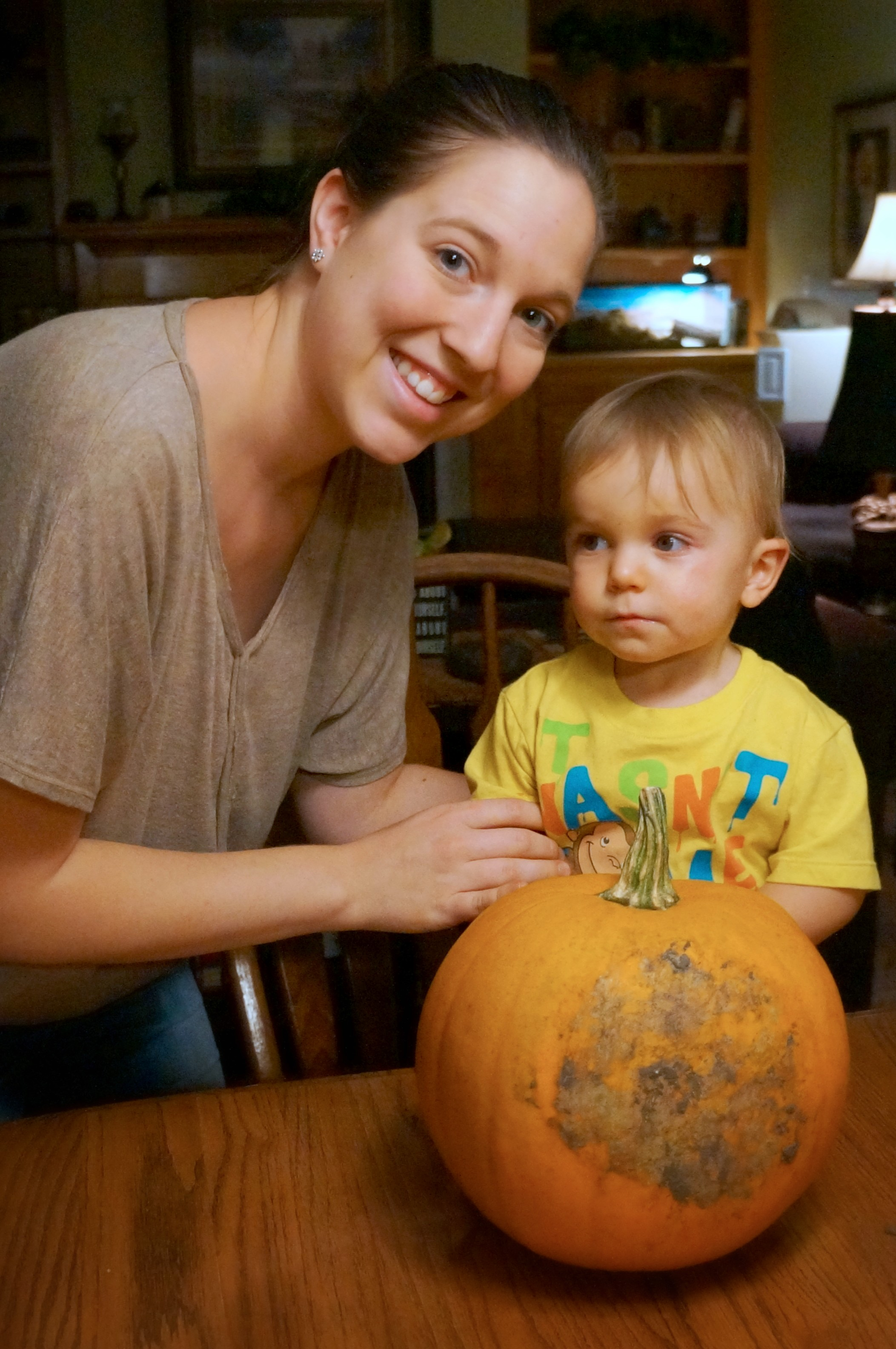 Mommy and Ryker carving their pumpkin