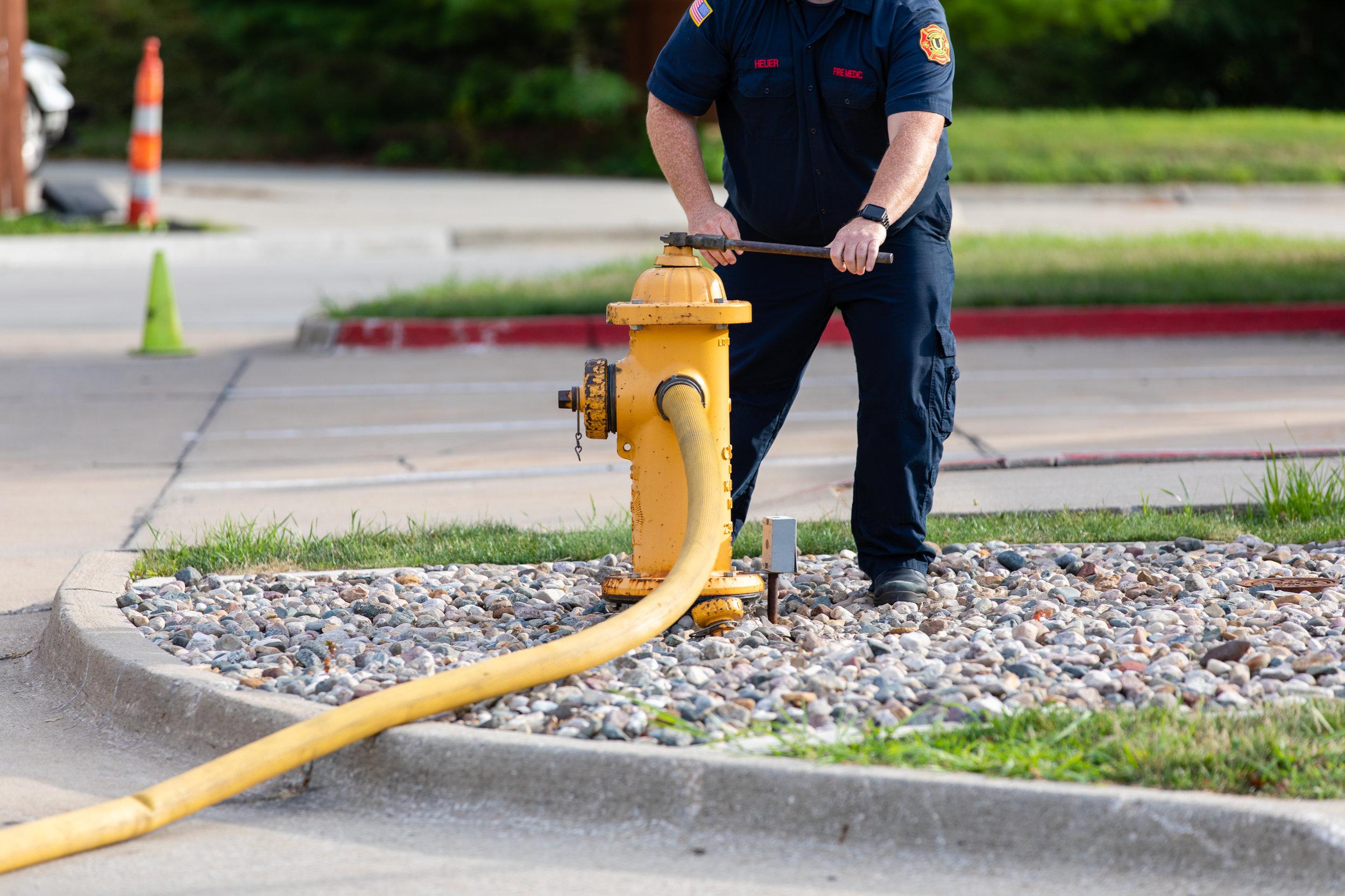 1H8A9335_firefighter hydrant hose.jpg