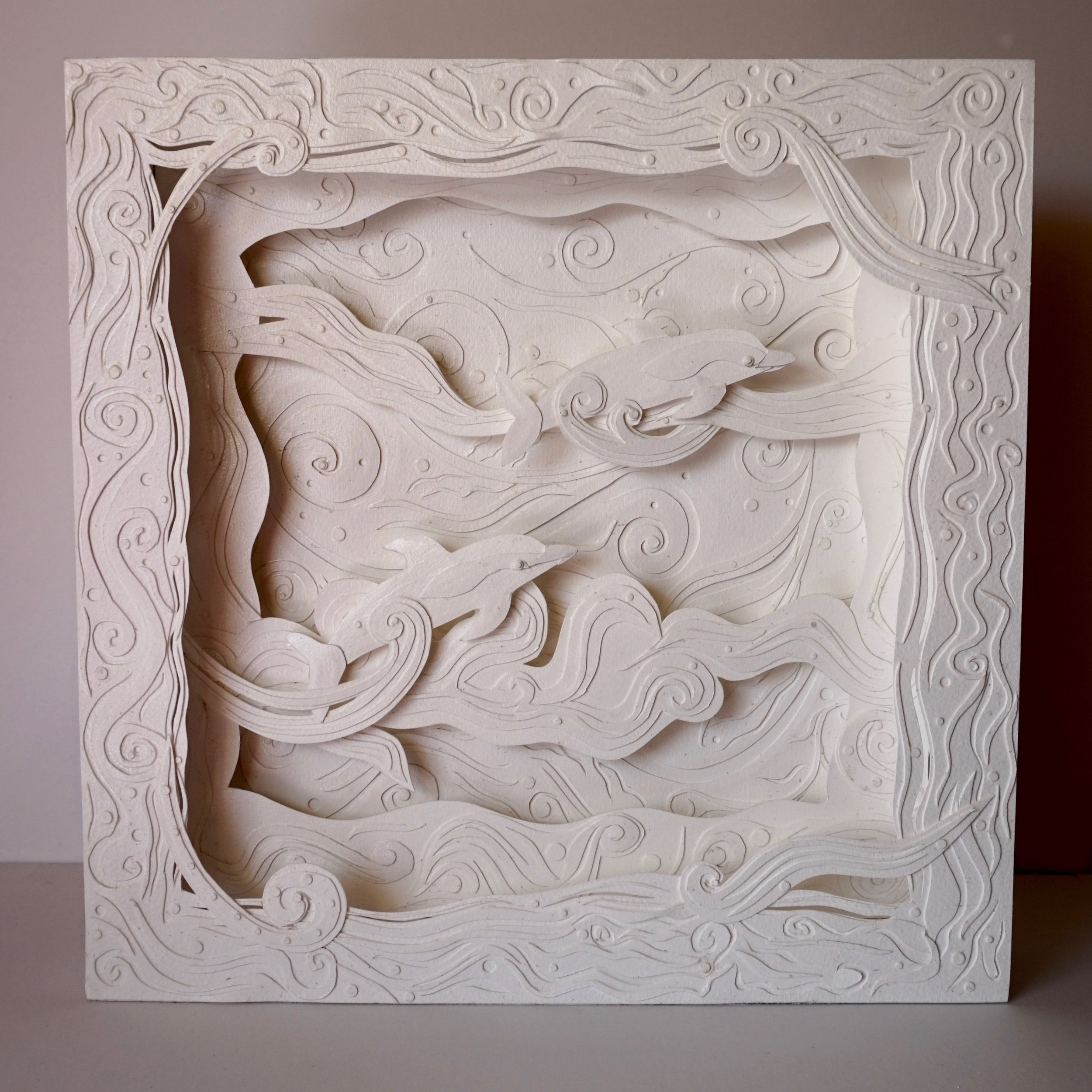 "Ride the Wave paper sculpture in 12"" x 12"" box."