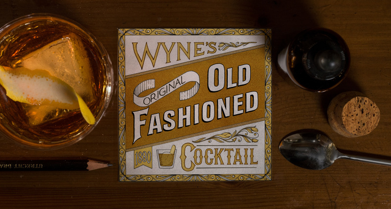 The Old Fashioned (1870s)  Spirits branding was in its infancy in the 1880s. The predominant practice of the time was to ship spirits in barrels to the bar, where bartenders would transfer the liquor to what were called back bar bottles. These bottles bore labels featuring oblique sans serif letters with gold leaf used as an accent. My illustration blends the look and feel of back bar labels with some more sophisticated lettering styles taken from bitters advertisements of the era.