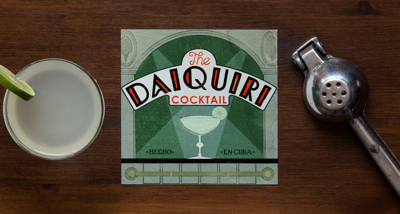 The Daiquiri (Early 1900s)  The illustration here references a copy of the La Florida bar's souvenir cocktail book. If Bacardi began the popularization of the Daiquiri, Ernest Hemingway completed it, and he was introduced to the Daiquiri by the previously mentioned Constantino at the Floridita (as it was known to locals.) Constantino made 4 signature Daiquiris, all of them very precise, but Hemingway, never one to defer, made Constantino customize the recipe of the Daiquiri number 4 for him, asking for no sugar and twice the rum. This Daiquiri was blended, which you see here in the illustration with the drink piled up above the rim of the glass.