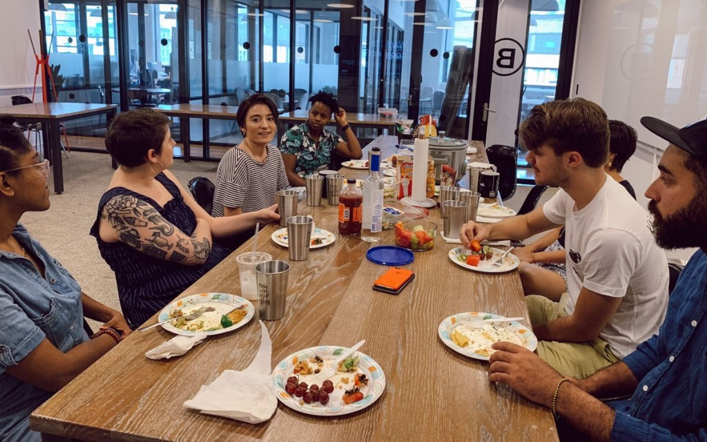 Creatives discussing how they define success over a potluck