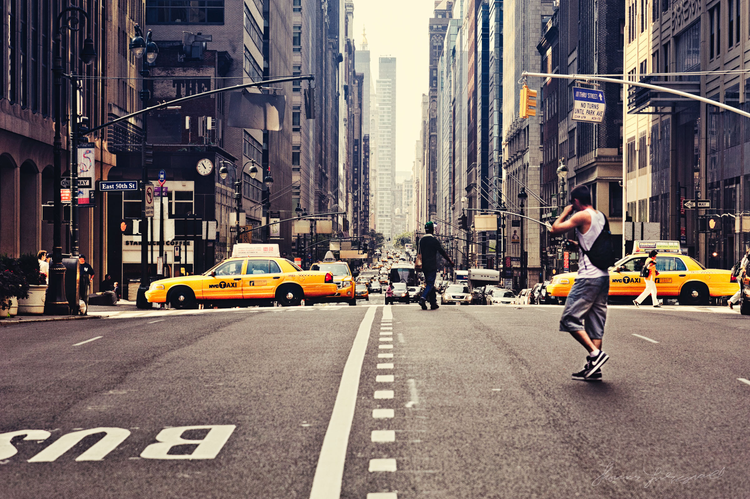 Guy crossing the Street in NYC