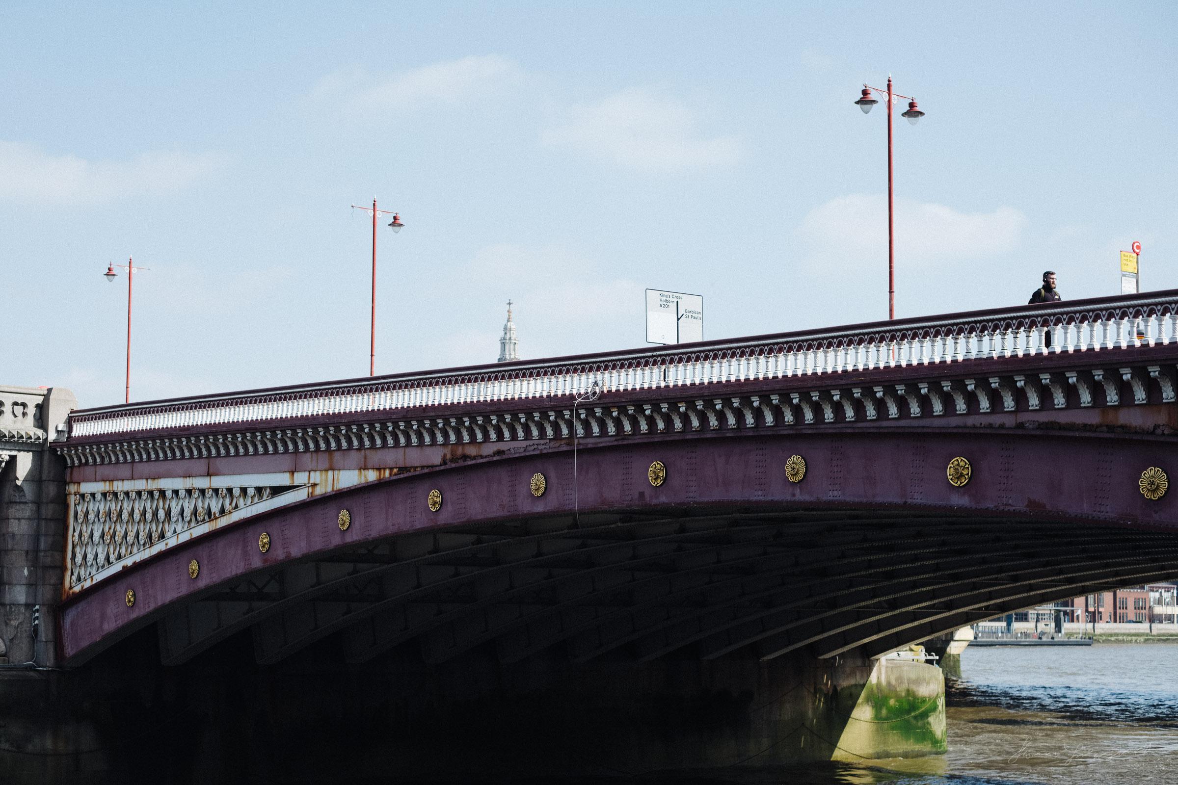 A single pedestrian crossing a London Bridge